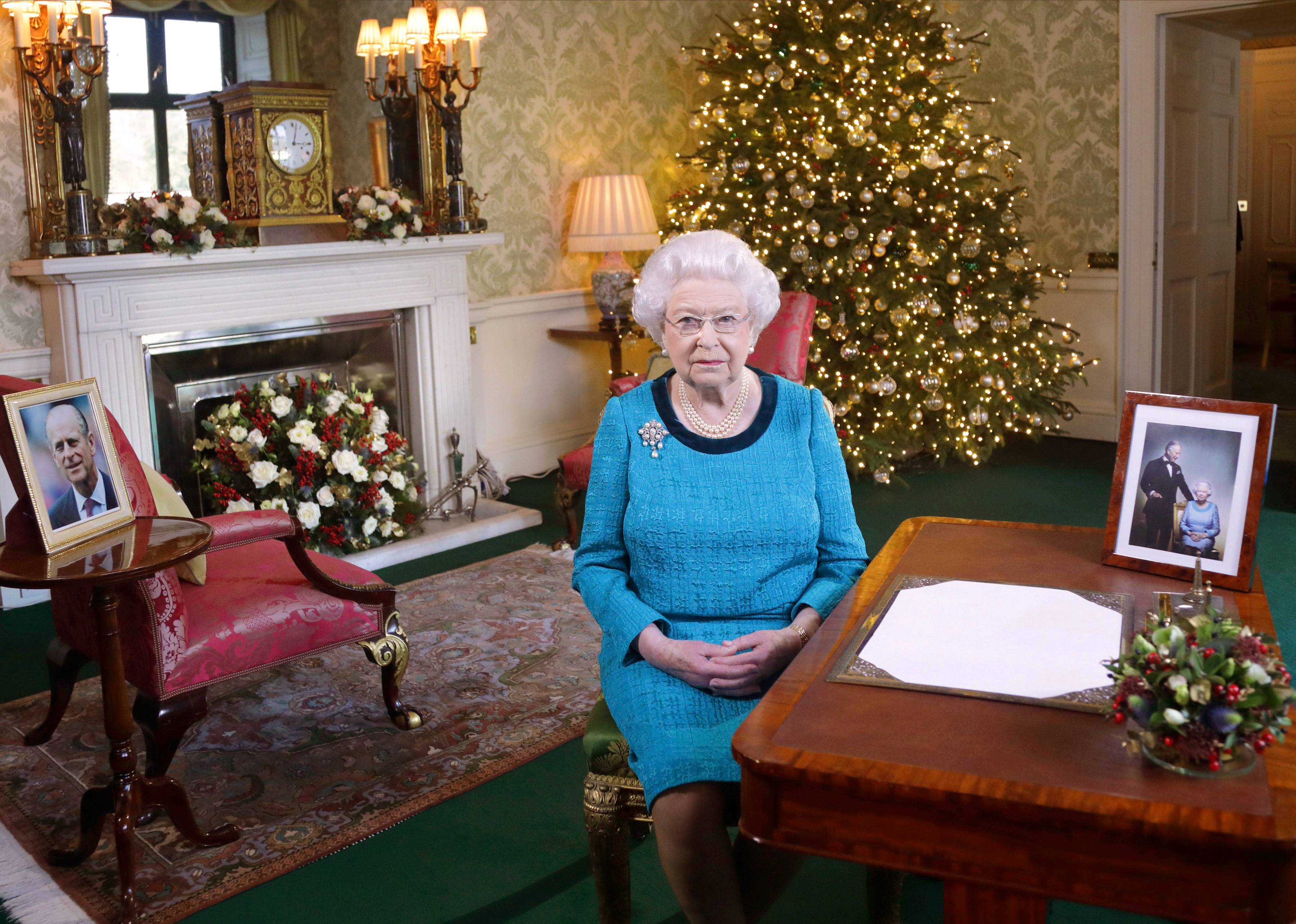 Queen Elizabeth II sits at a desk in the Regency Room after recording her Christmas Day broadcast to the Commonwealth at Buckingham Palace on December 24, 2016 in London, England.