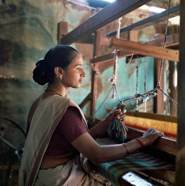 SEWA economic initiative for sari and cloth makers in Sinhol town of Gujarat.  All cloth is pre-ordered and made with traditional methods on wooden looms and using organic fabric, such as cotton. SEWA member Geeta Bhen 38 y.o. has worked there for 6 months and is planning to save the money she earns here for her retirement fund. Gujarat, India. March, 2013