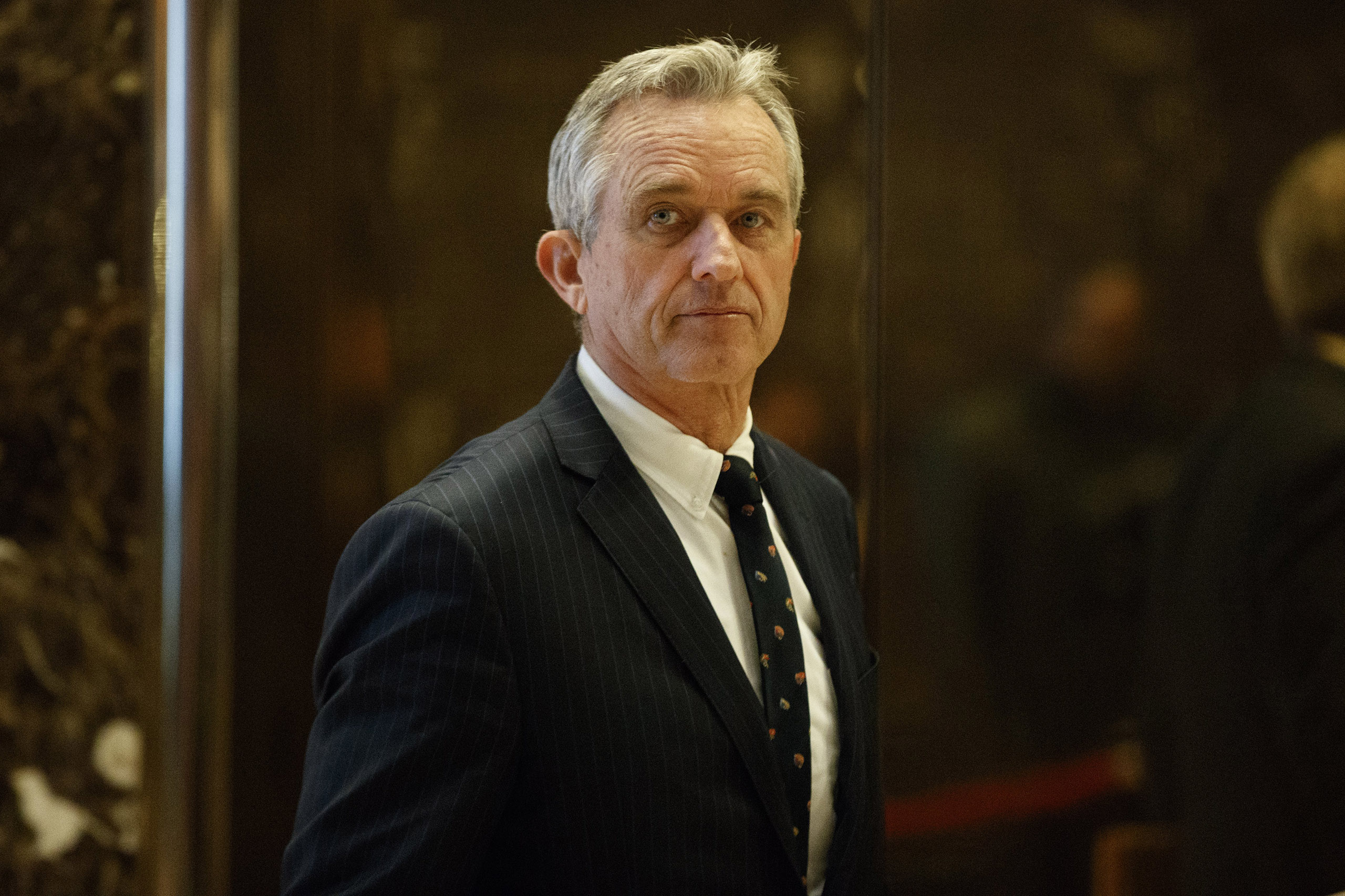 Robert F. Kennedy Jr. arrives in the lobby of Trump Tower for a meeting with President-elect Donald Trump, in New York, on Jan. 10, 2017.