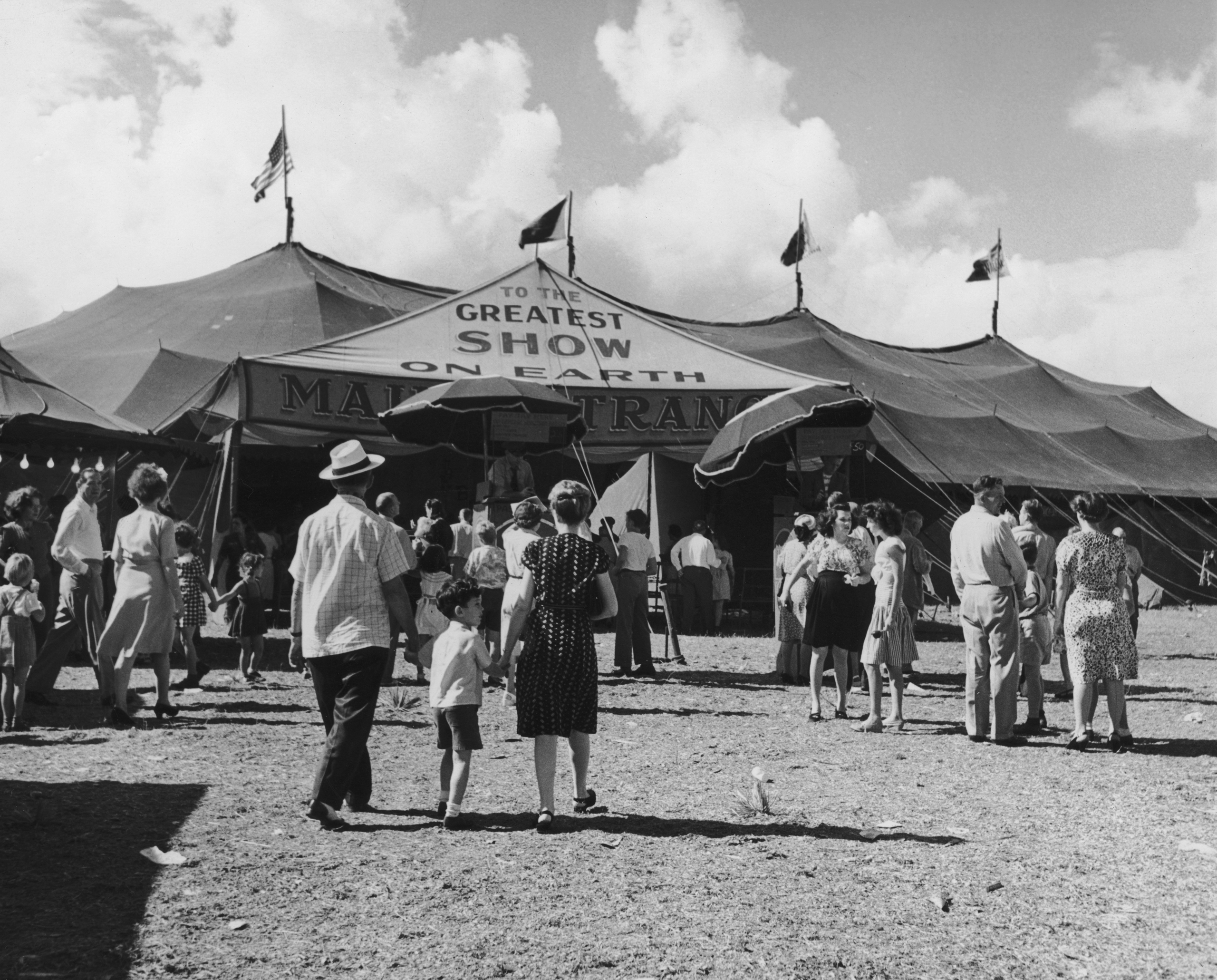 Visitors heading to the big top to see 'The Greatest Show On Earth' performance from the Ringling Bros, Barnum & Bailey circus, circa 1950.