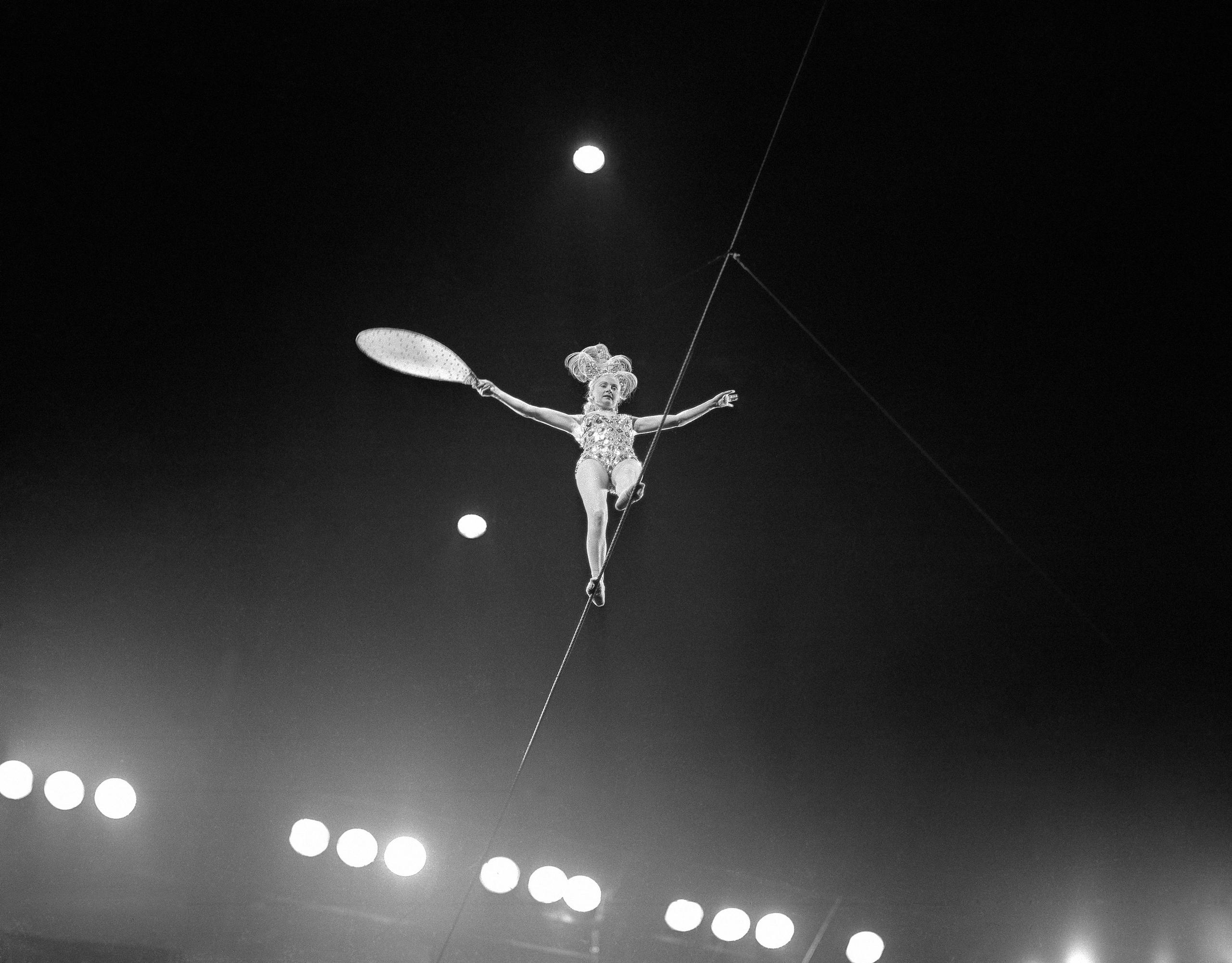 A performer walking the rope at a Ringling Bros, Barnum & Bailey circus, circa 1955.
