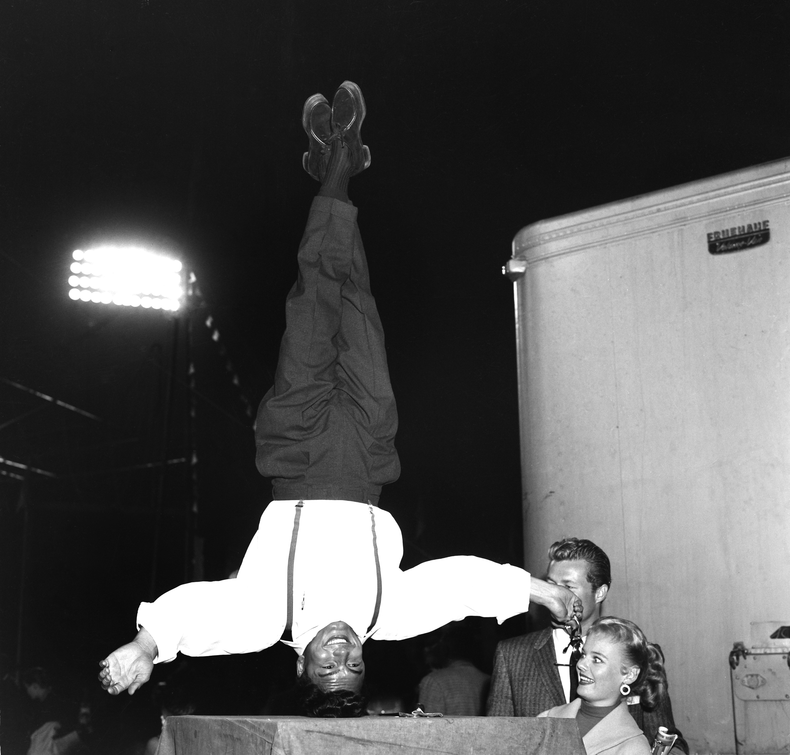 A women and man poses with an acrobat at the Ringling Bros. and Barnum & Bailey Circus in Los Angeles on Oct. 15, 1957.