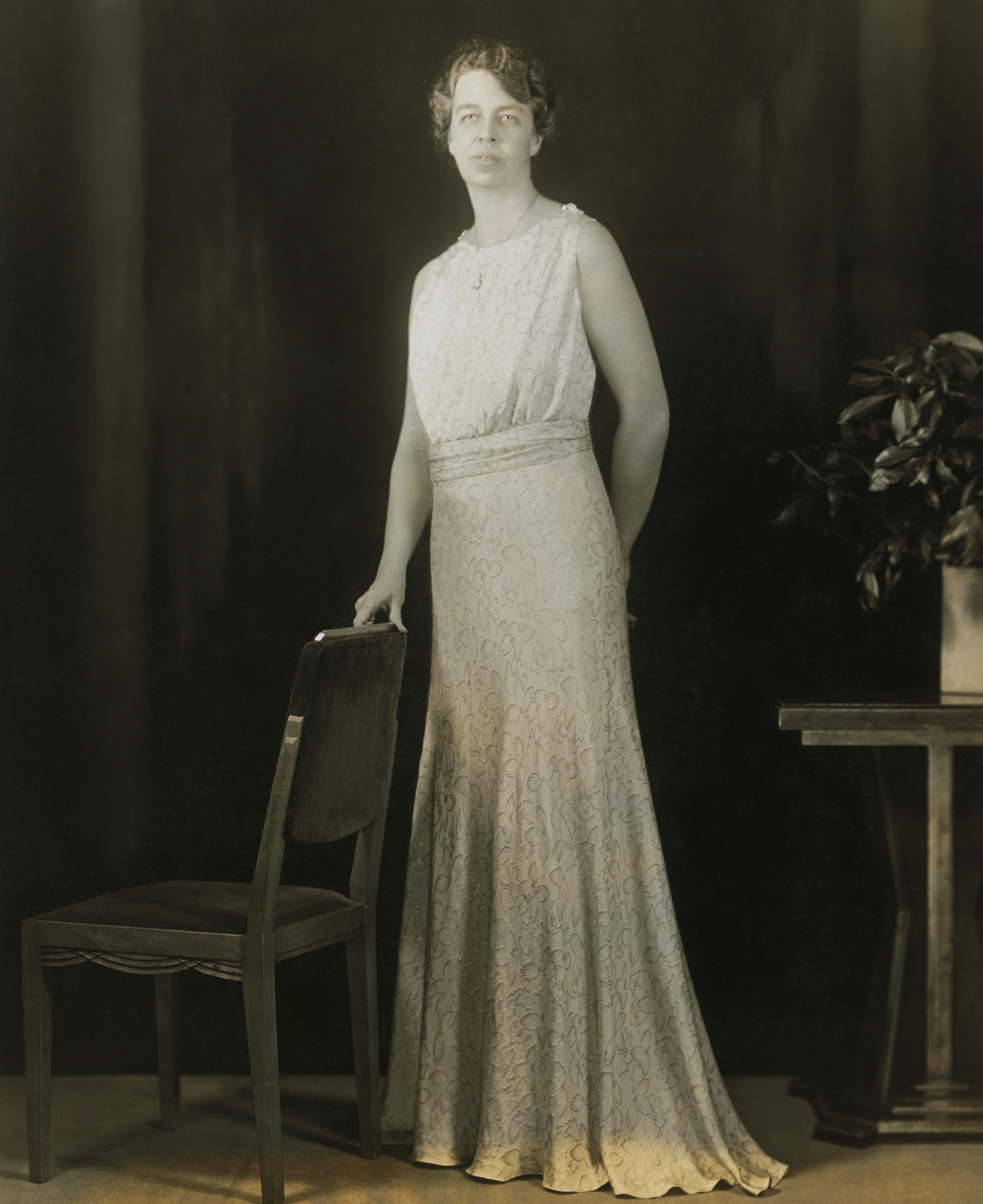 Eleanor Roosevelt, Sally Milgrim, 1933: Roosevelt wore a slate-blue silk crepe gown with a gold leaf-and-flower pattern, plus belt buckle and shoulder clips made out of rhinestone and moonstone.