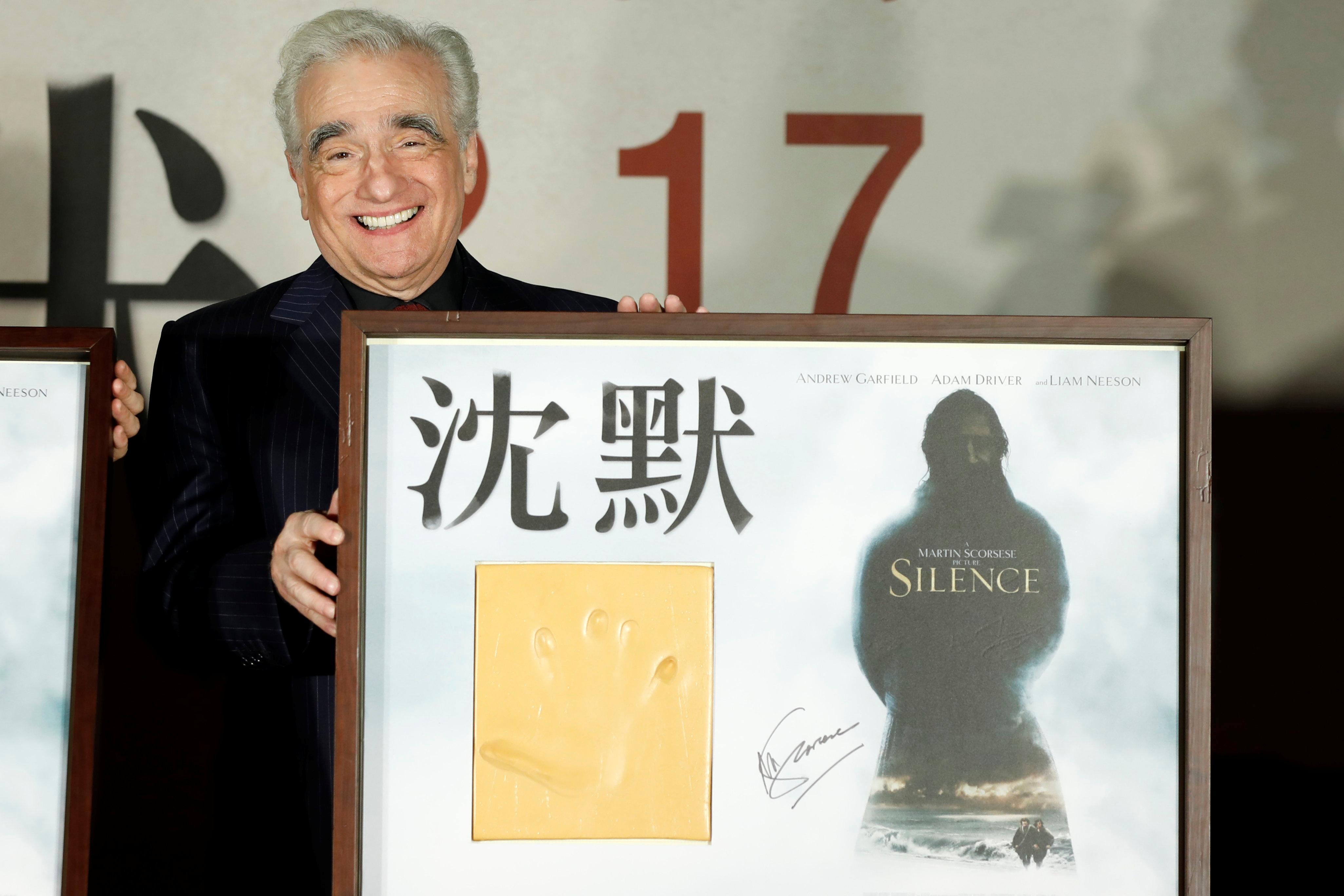 Director Martin Scorsese poses with his handprint during the premiere of  Silence , in Taipei, Taiwan Jan. 19, 2017.