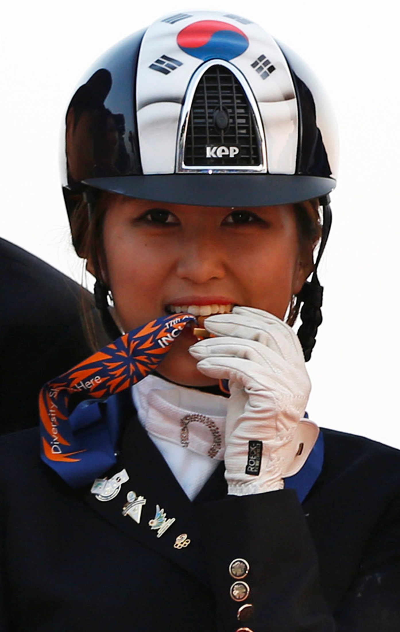Chung Yoo-ra, then known as Chung Yoo-yeon, after winning the equestrian Dressage Team competition at the 17th Asian Games in Sept. 20, 2014.