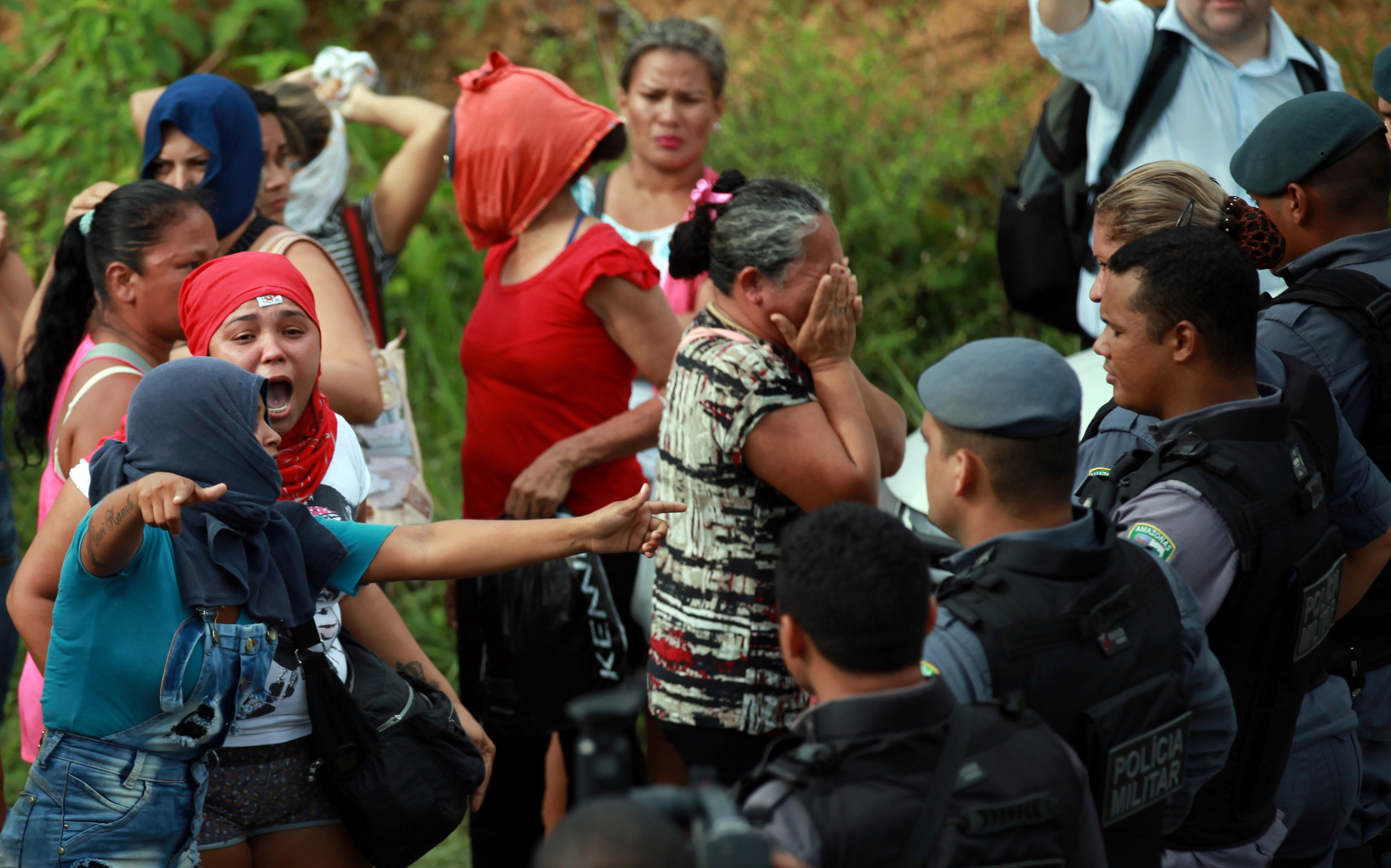 Relatives of prisoners react at a checkpoint close to the prison where around 60 people were killed in a prison riot in  Manaus, Brazil on Jan. 2, 2017.