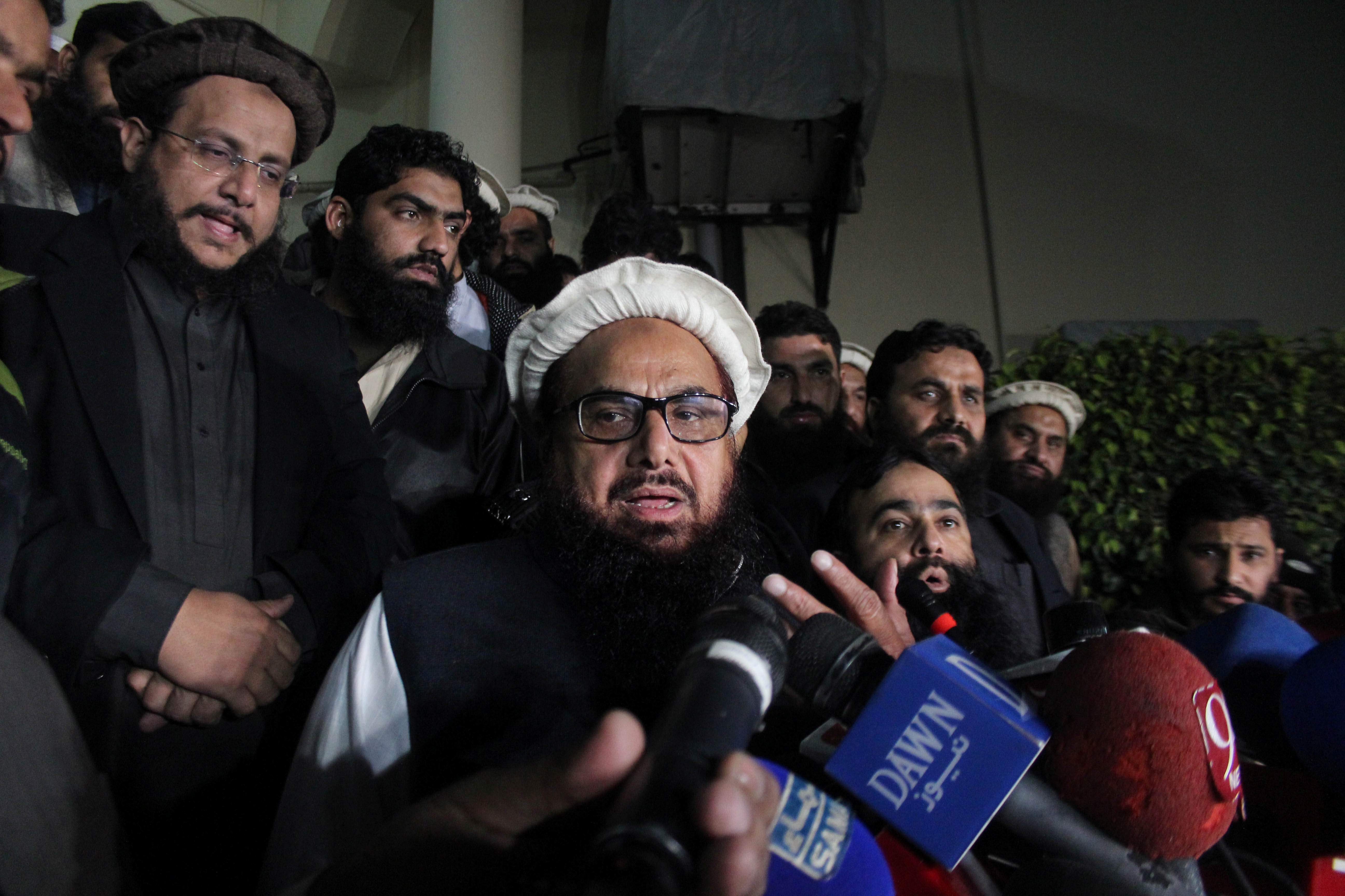 Hafiz Muhammad Saeed, chief of Jamat-ud-Dawa, speaks with media as he is escorted to his home where he will be under house arrest in Lahore, Pakistan on Jan. 30, 2017.