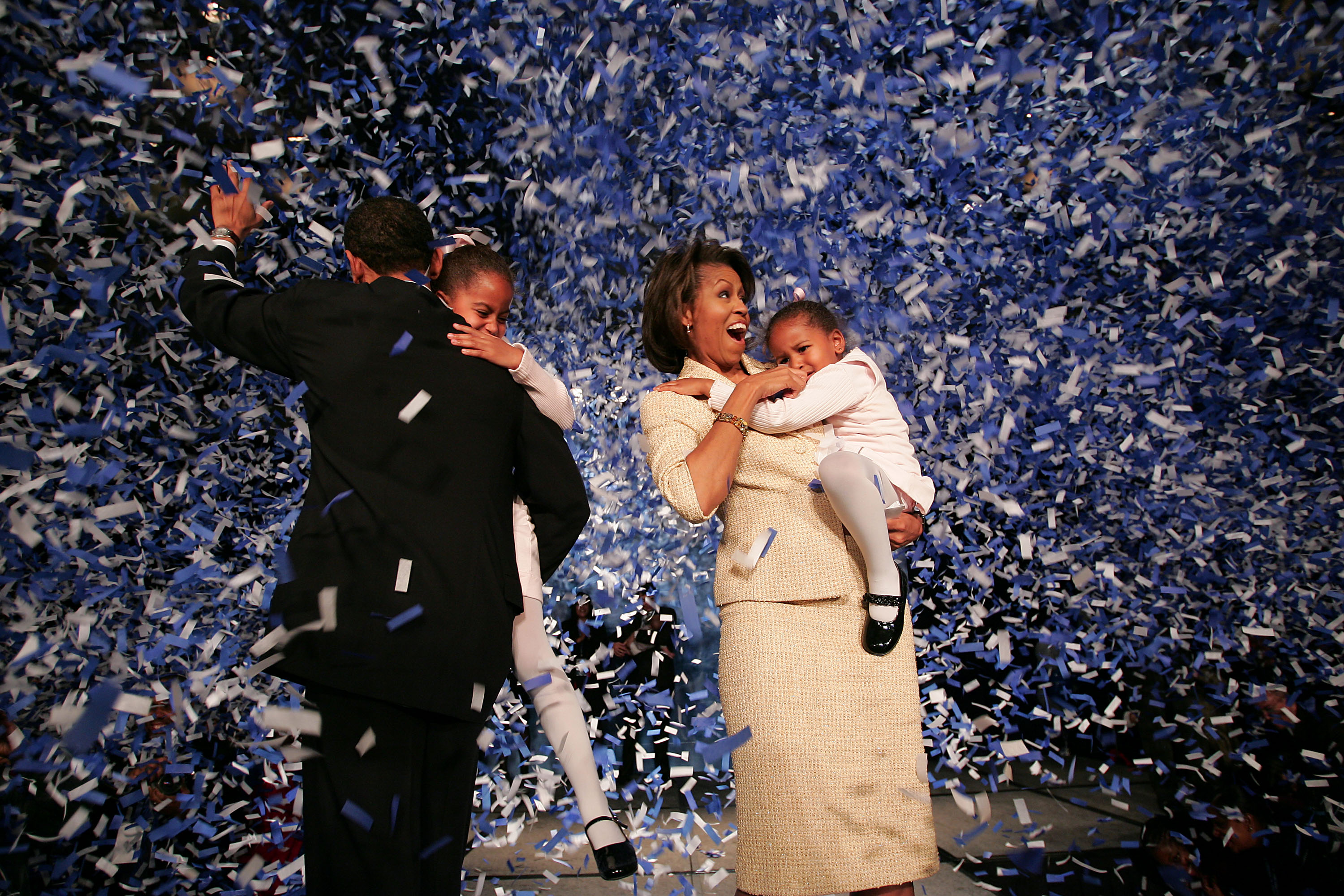 Then-candidate for the U.S. Senate Barack Obama celebrates with his daughters Malia and Sasha and wife Michelle during a victory party in Chicago on Nov. 2, 2004.