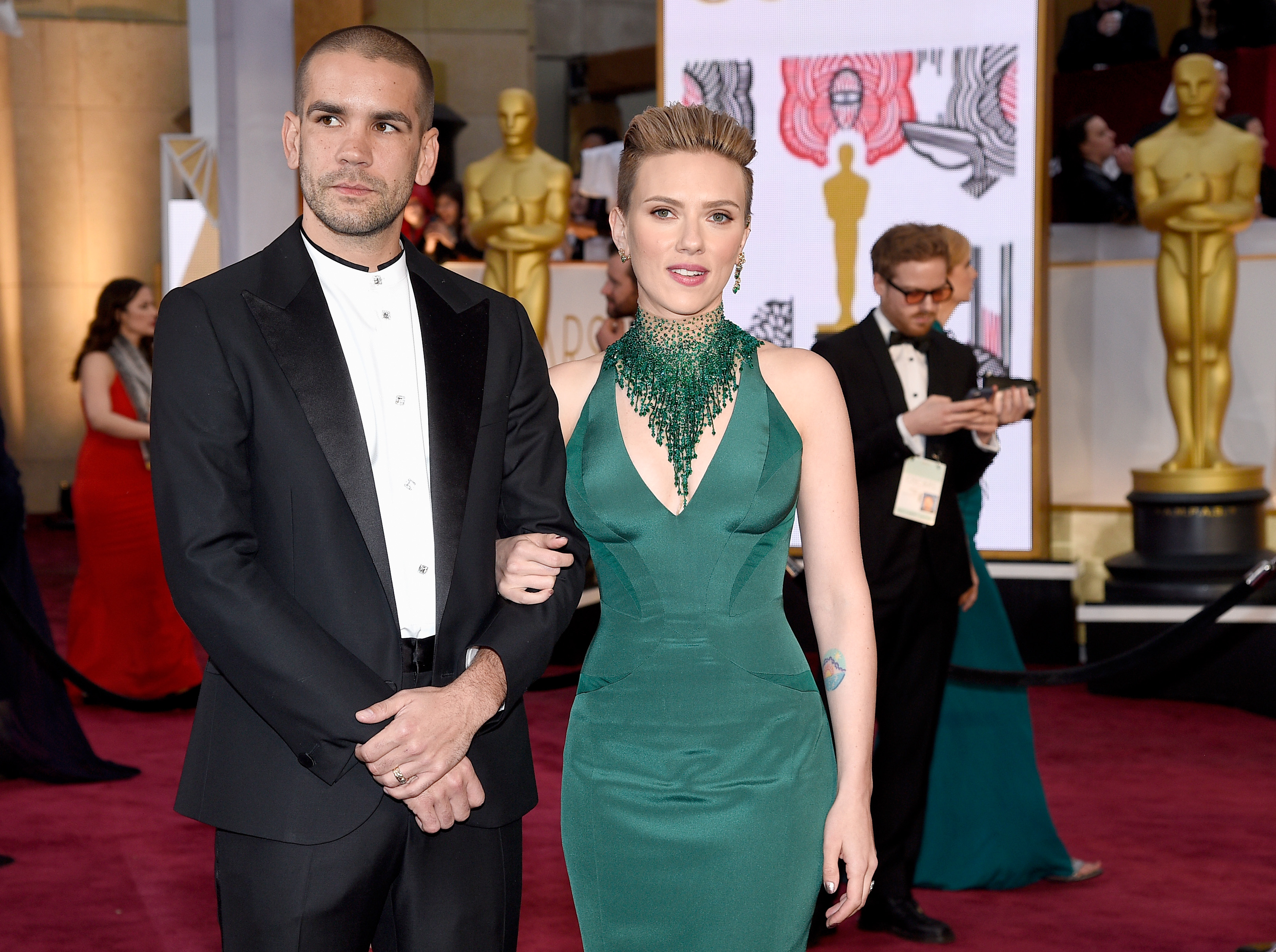 Actress Scarlett Johansson (R) and Romain Dauriac attend the 87th Annual Academy Awards at Hollywood & Highland Center on February 22, 2015 in Hollywood, California.