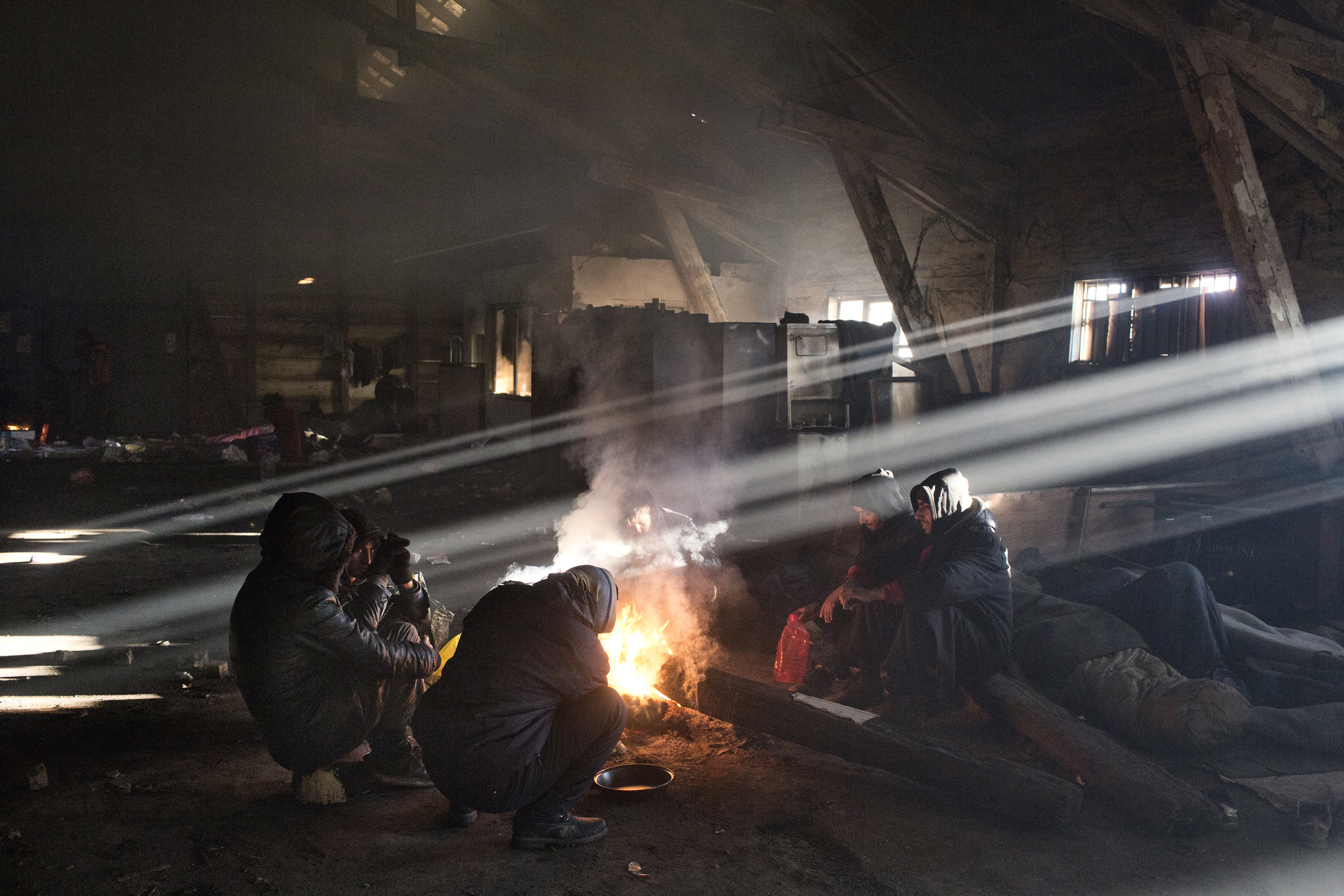 A group of unaccompanied minors inside an abandoned building in Belgrade, Serbia, where they wait for smugglers to help them enter the EU.