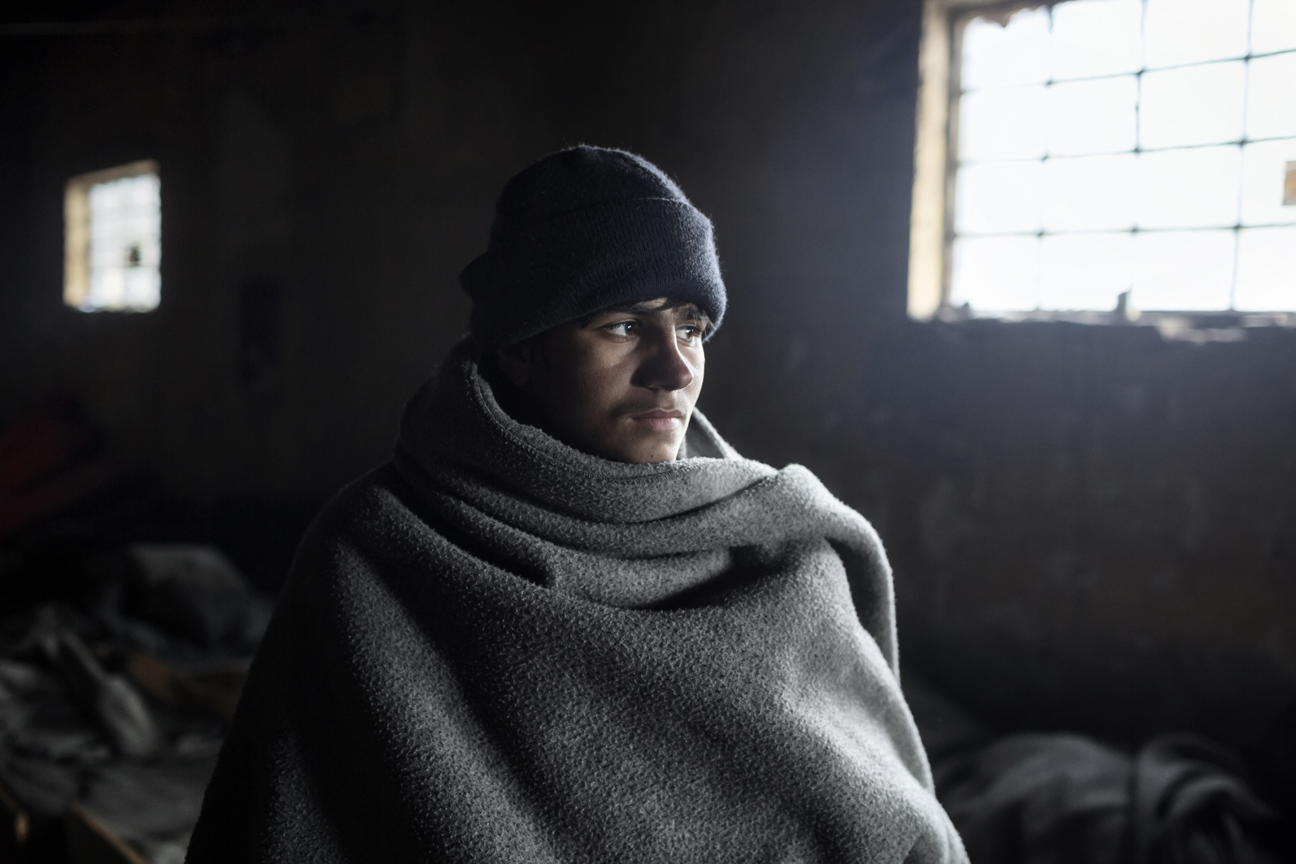 Handar, 14, an unaccompanied minor from Afghanistan lives in an abandoned building near the train station in Belgrade, Serbia, Jan. 2017.