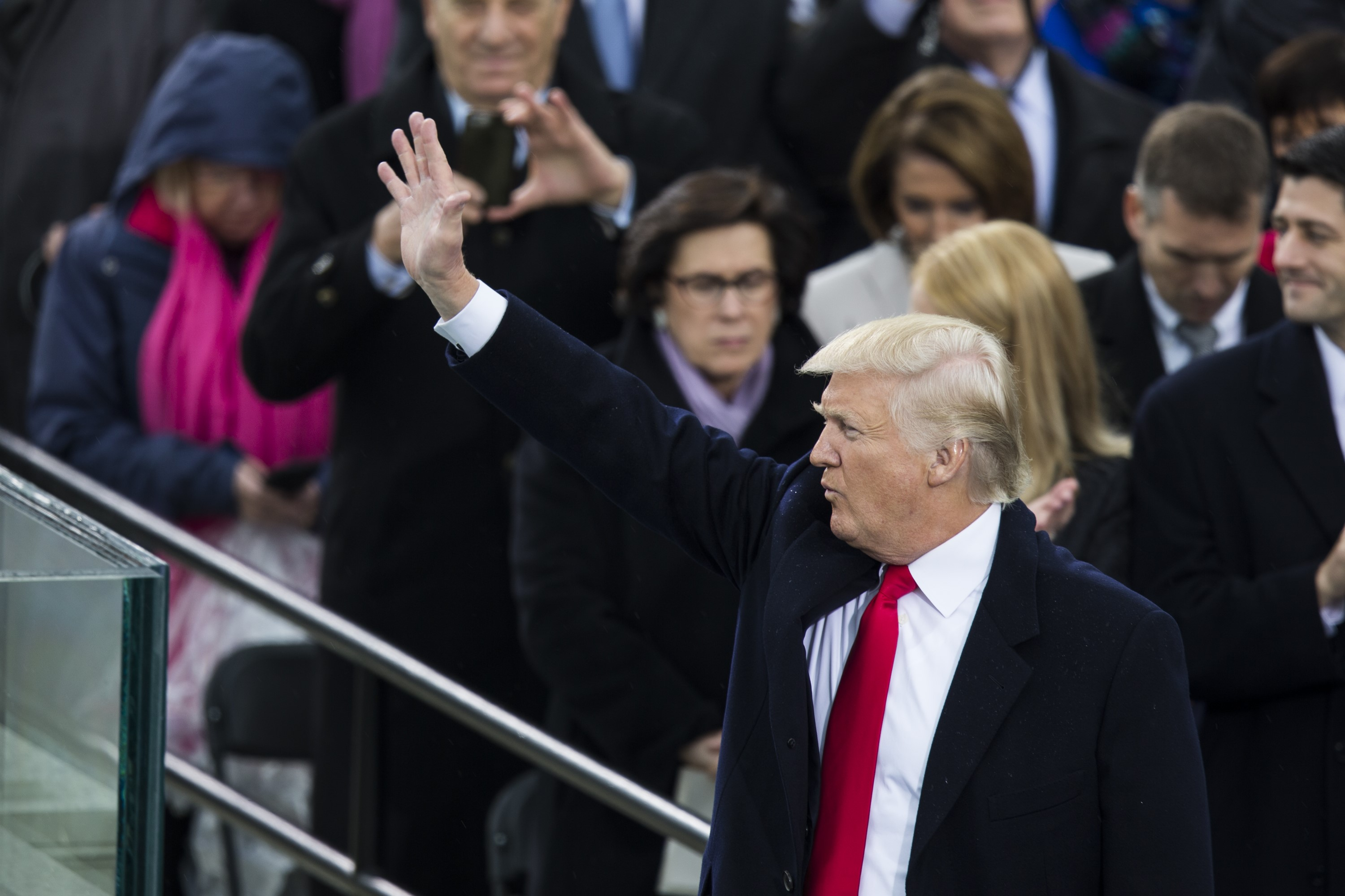 WASHINGTON, USA - JANUARY 20: President Donald Trump waves to the crowds during the 58th U.S. Presidential Inauguration after he was sworn in as the 45th President of the United States of America in Washington, USA on January 20, 2017.