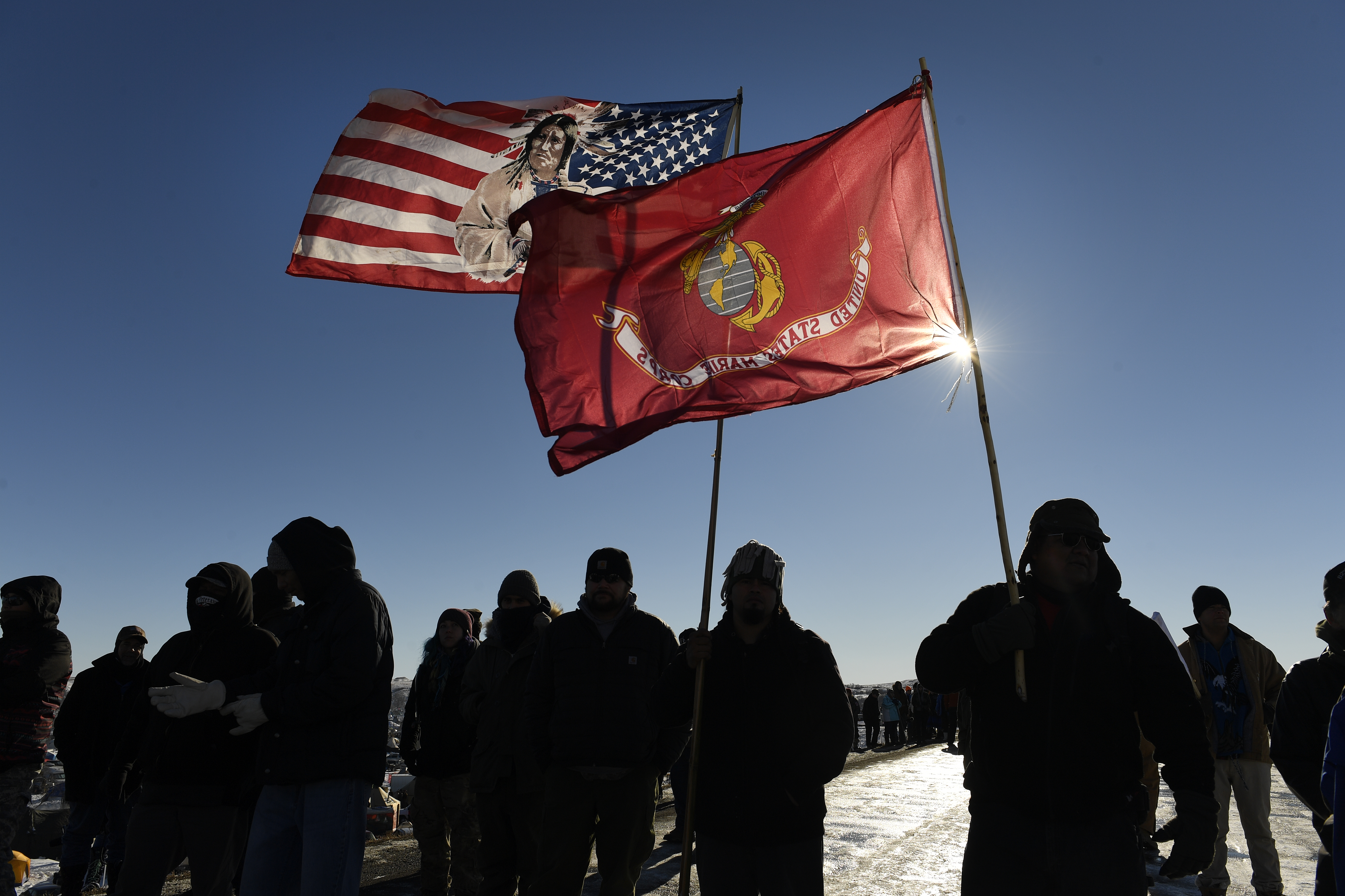 USveterans and native americans hold flags in solidarity at the Standing Rock Sioux Reservation on Dec. 4, 2016 outside Cannon Ball, North Dakota.