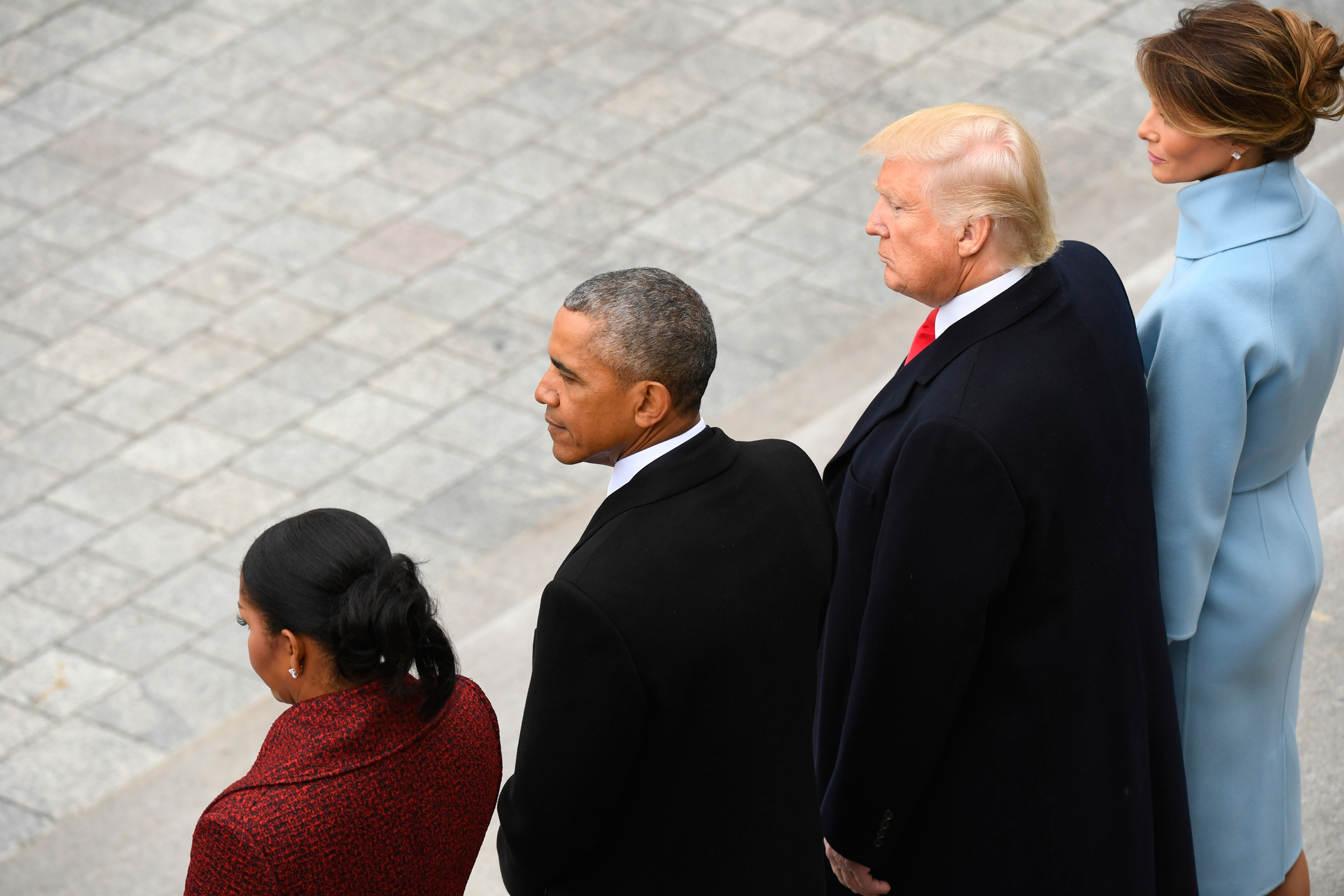 Former President Barack Obama and his wife Michelle Obama stand with President Donald Trump and his wife Melania Trump on the East front                      of the Capitol Hill in Washington on Jan. 20, 2017.