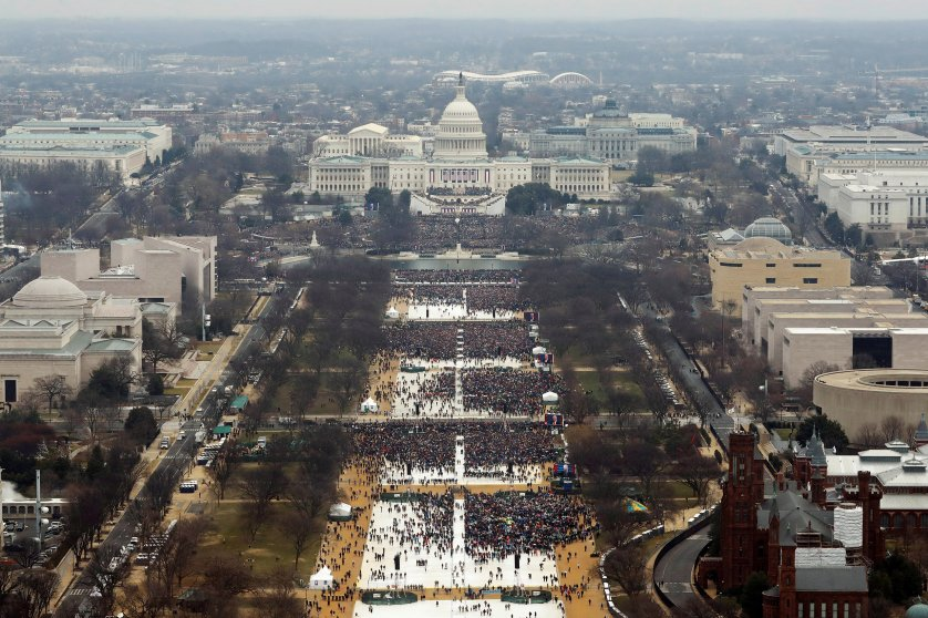 Attendees line the Mall as they watch ceremonies to swear in Donald Trump on Inauguration Day on Jan. 20, 2017 in Washington.