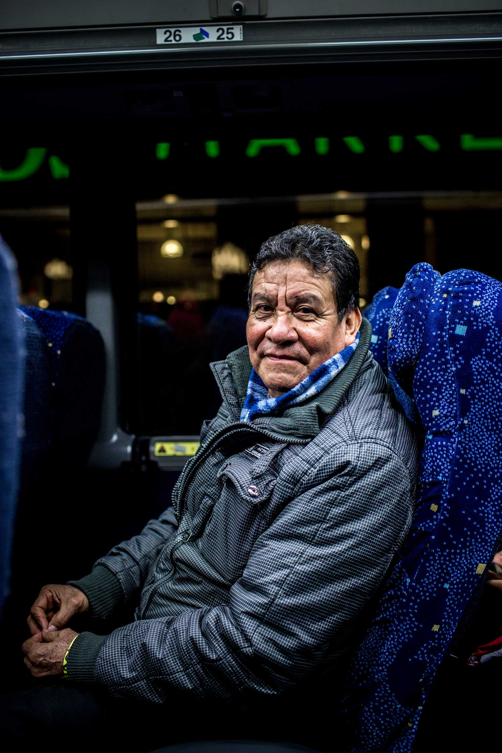 1:42 AM:  Poli Cortez, a plant seller originally from Mexico, poses for a portrait. It's my duty to continue to struggle for the people,  he says when I ask him why he's going to Washington.