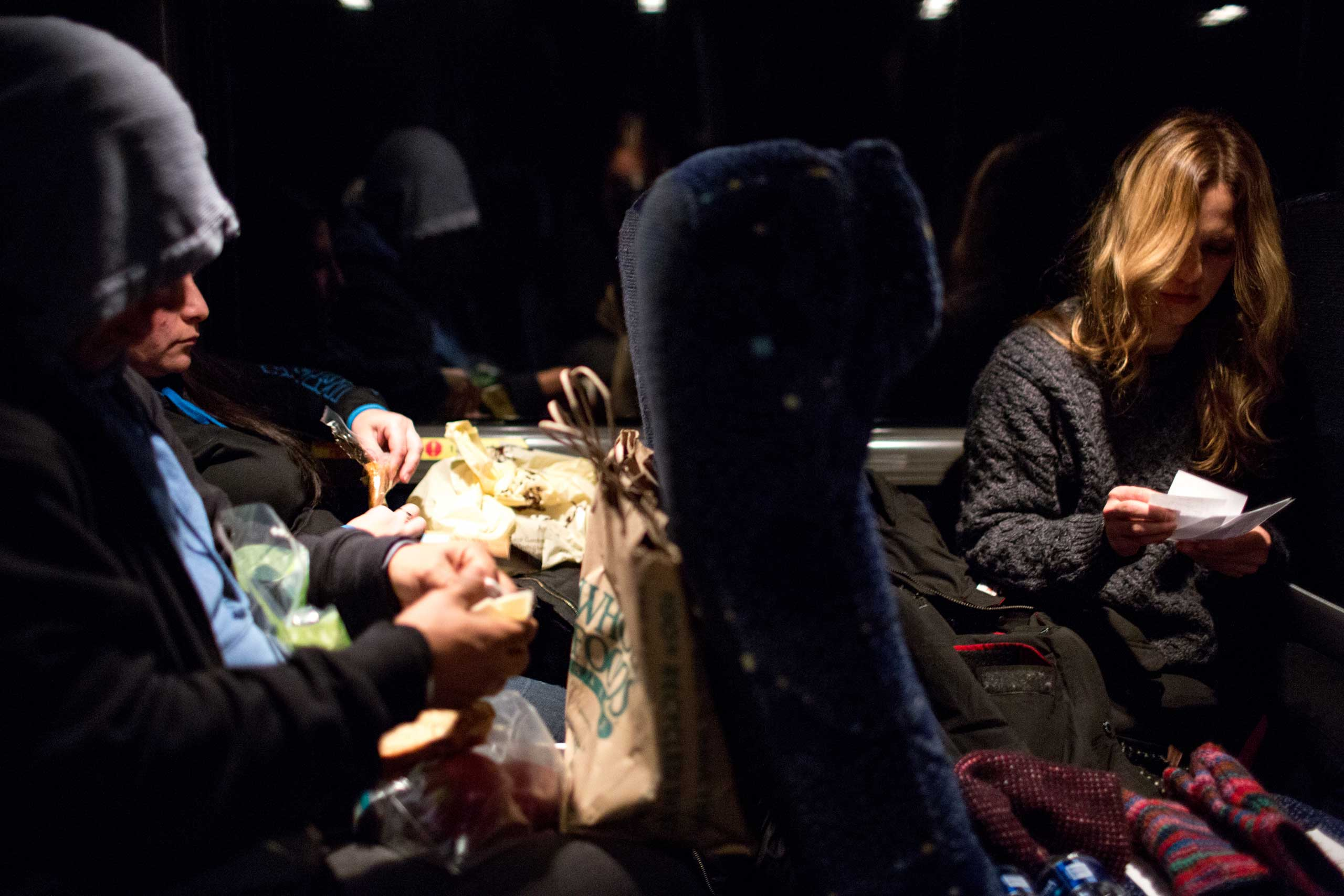 5:28 AM: Anna plans her protest sign while other activists prepare their lunches around 5am as the bus approaches D.C.