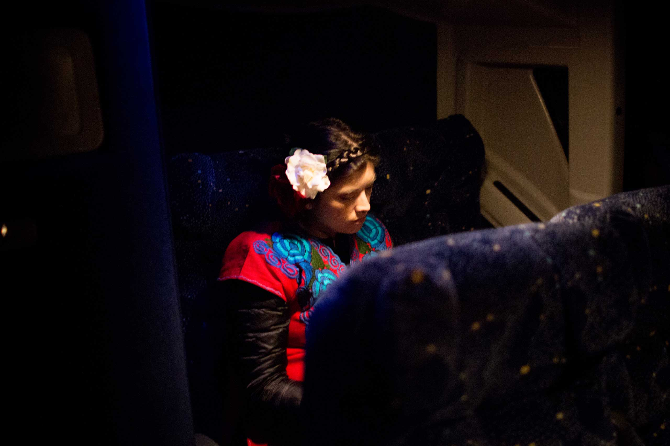 5:33 AM: Karina Garcia, 31, is one of the main organizers of the Answer Coalition event. As we approach D.C., she takes a moment to rest.