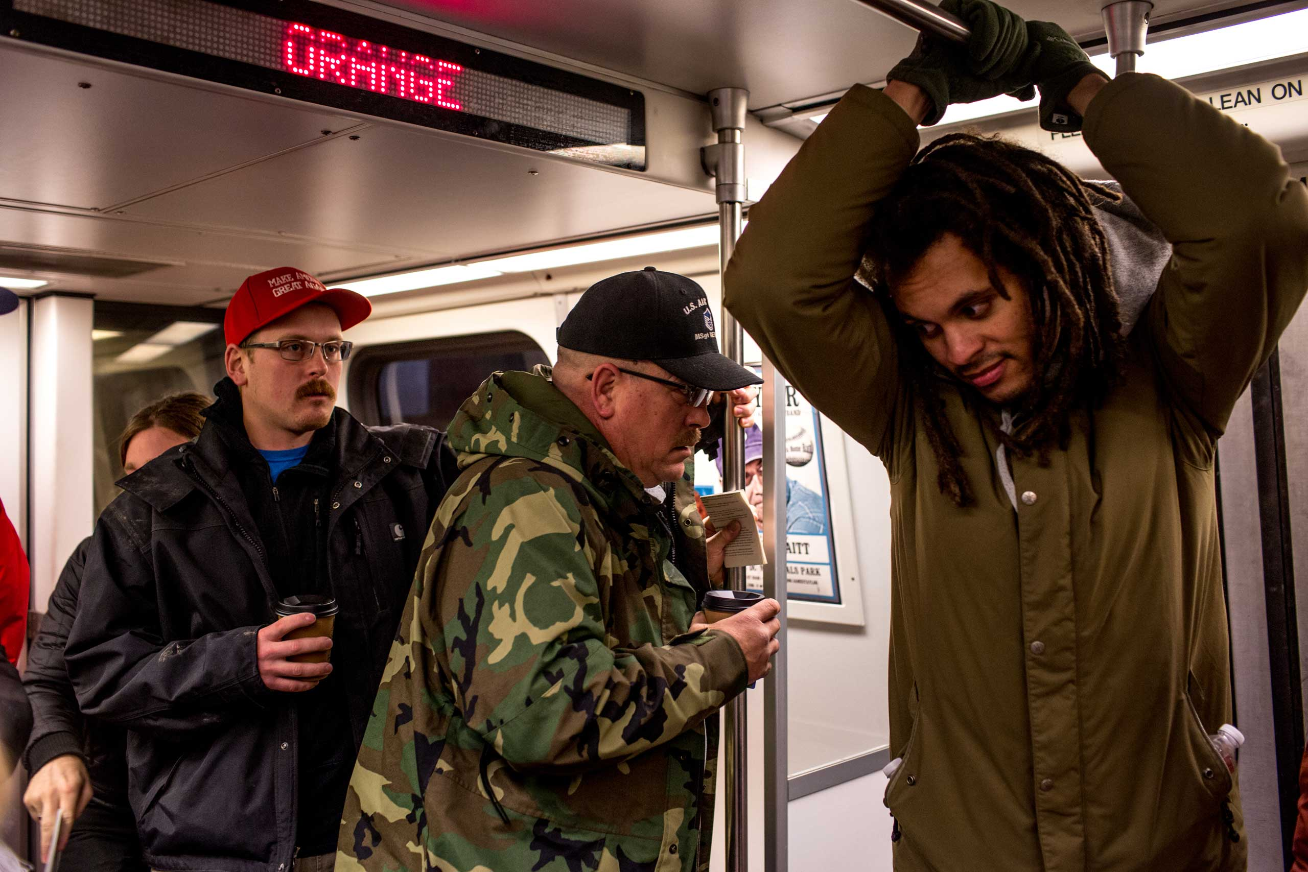 6:45 AM: A group of Trump supporters rides the metro next to an activist from New York. The tension is palpable but no one's talking.