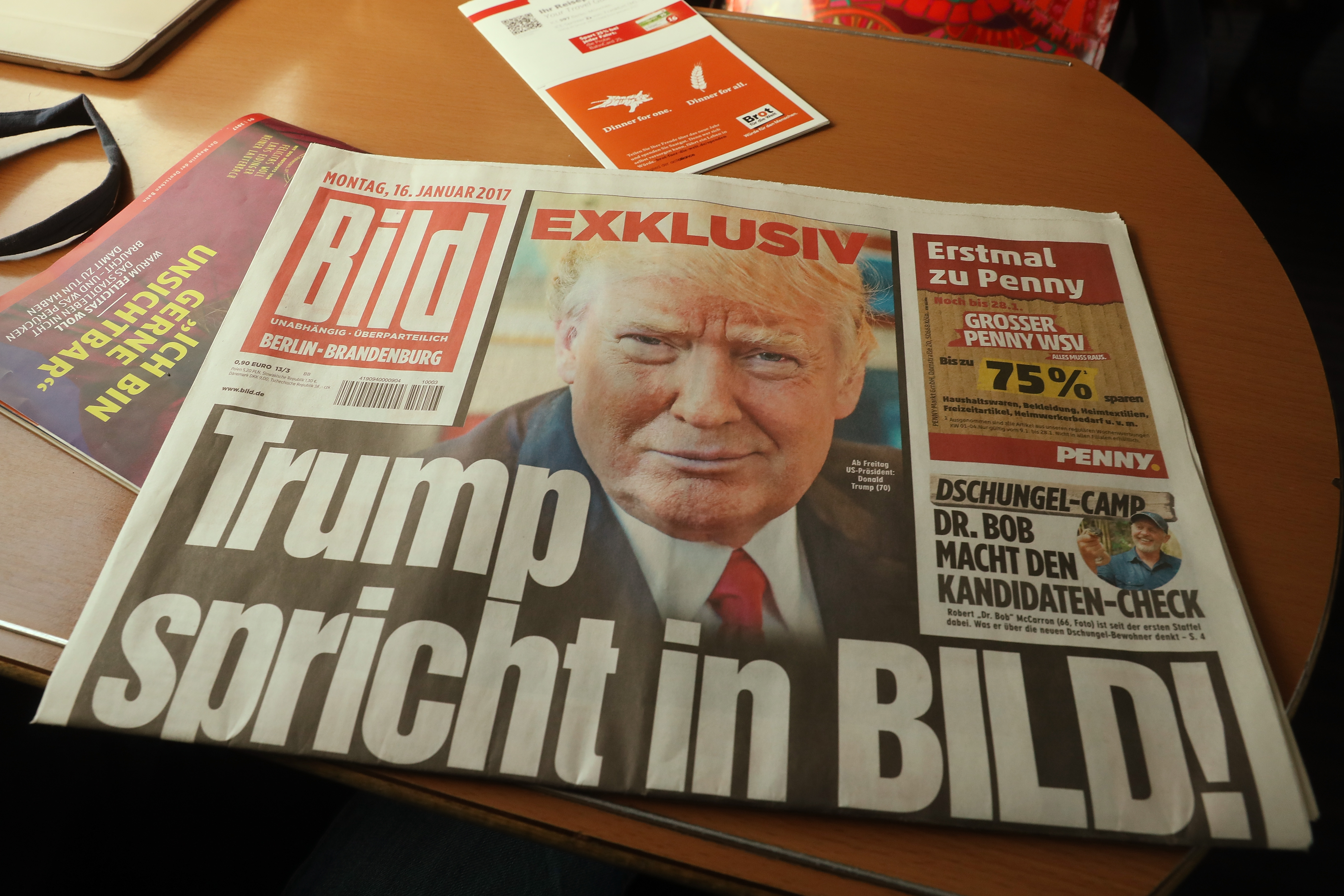 A copy of the January 16 issue of German tabloid Bild Zeitung that features an exclusive interview with U.S. President-elect Donald Trump lies on a table in a train in Berlin, Germany on Jan. 16, 2017.
