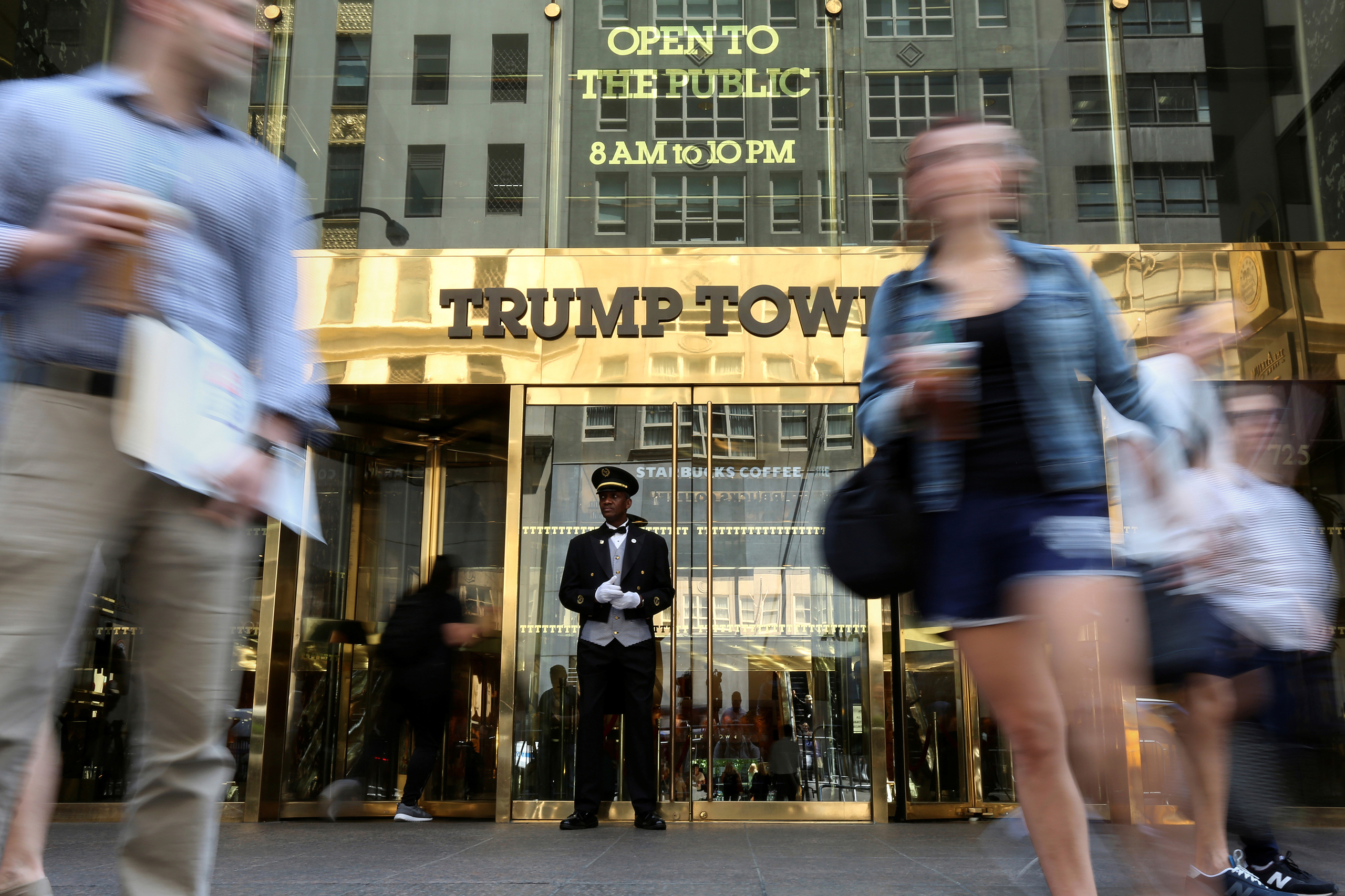 People walk past the Trump Tower in New York on May 23, 2016.