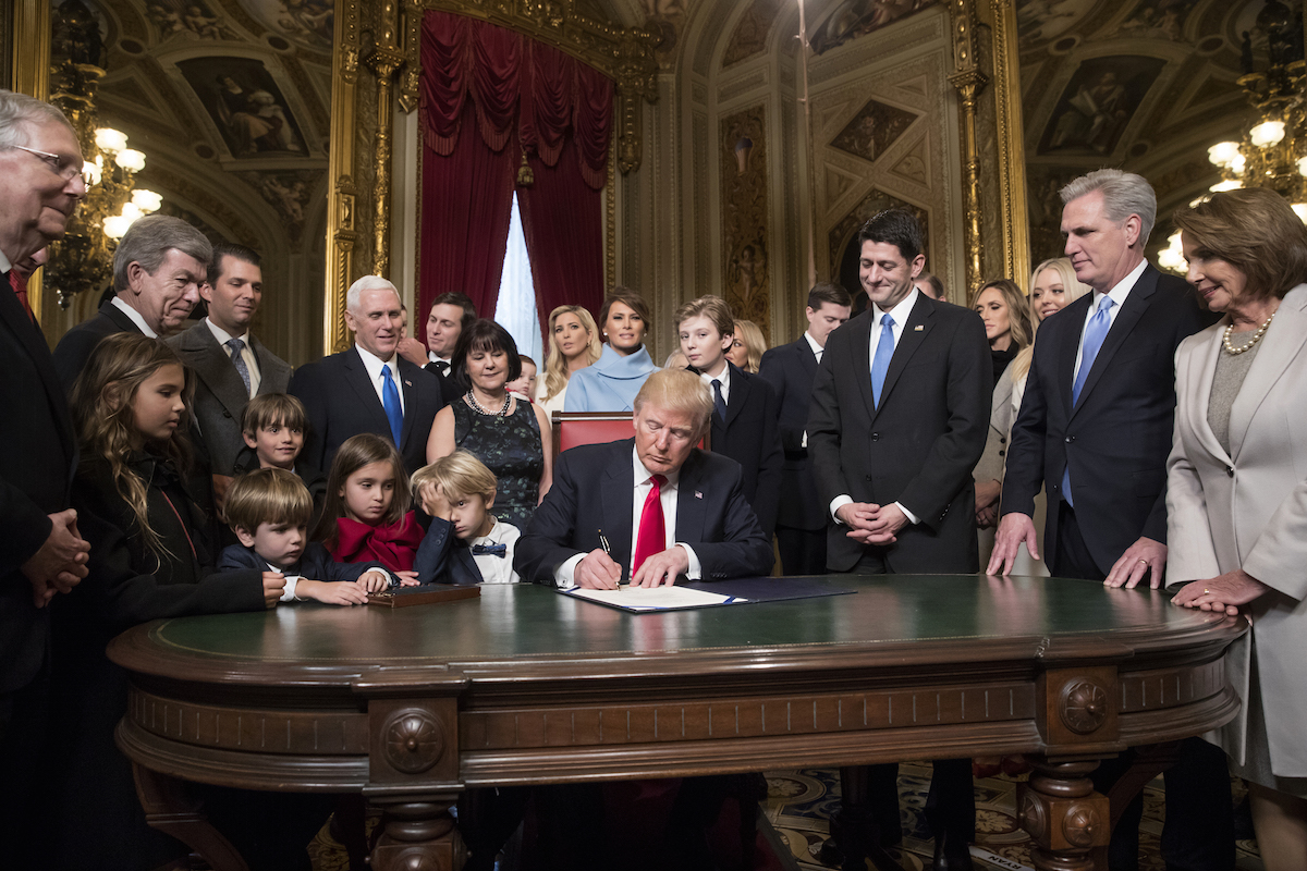 U.S. President Donald Trump, center, prepares to formally sign his cabinet nominations into law with U.S. House Speaker Paul Ryan, a Republican from Wisconsin, from second left, House Majority Leader Kevin McCarthy, a Republican from California, and House Minority Leader Nancy Pelosi, a Democrat from California, during the 58th presidential inauguration in Washington, D.C., on Jan. 20, 2017.
