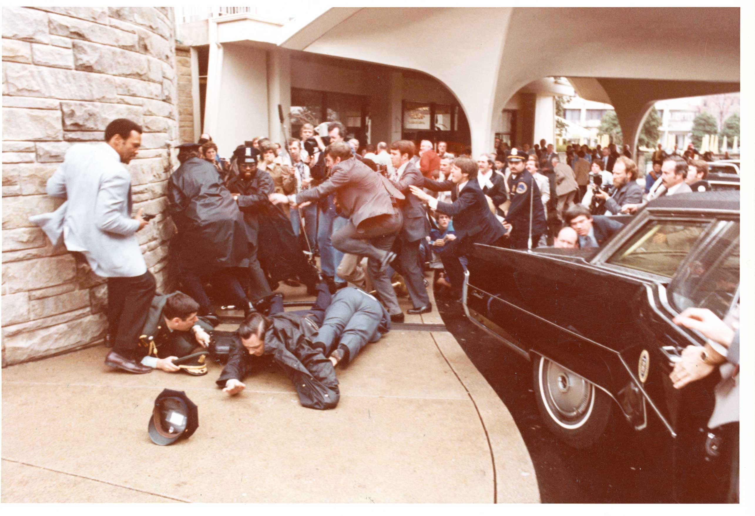 The scene immediately after the shooting of Ronald Reagan. Press Sec. James Brady and agent Delahanty are on the floor.