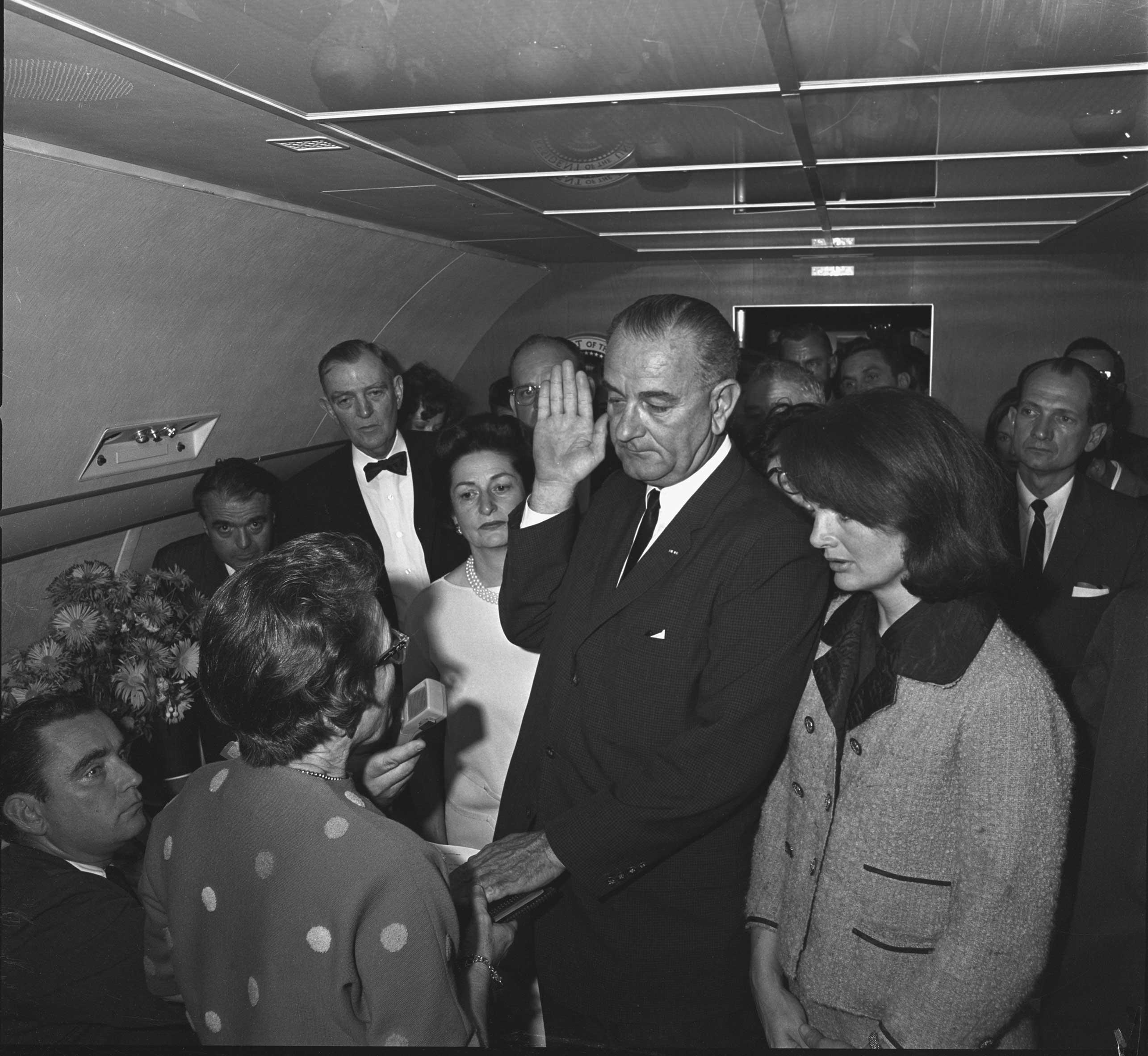 Swearing in of Lyndon B. Johnson as President aboard Air Force One, Love Field, Dallas, on Nov. 22, 1963