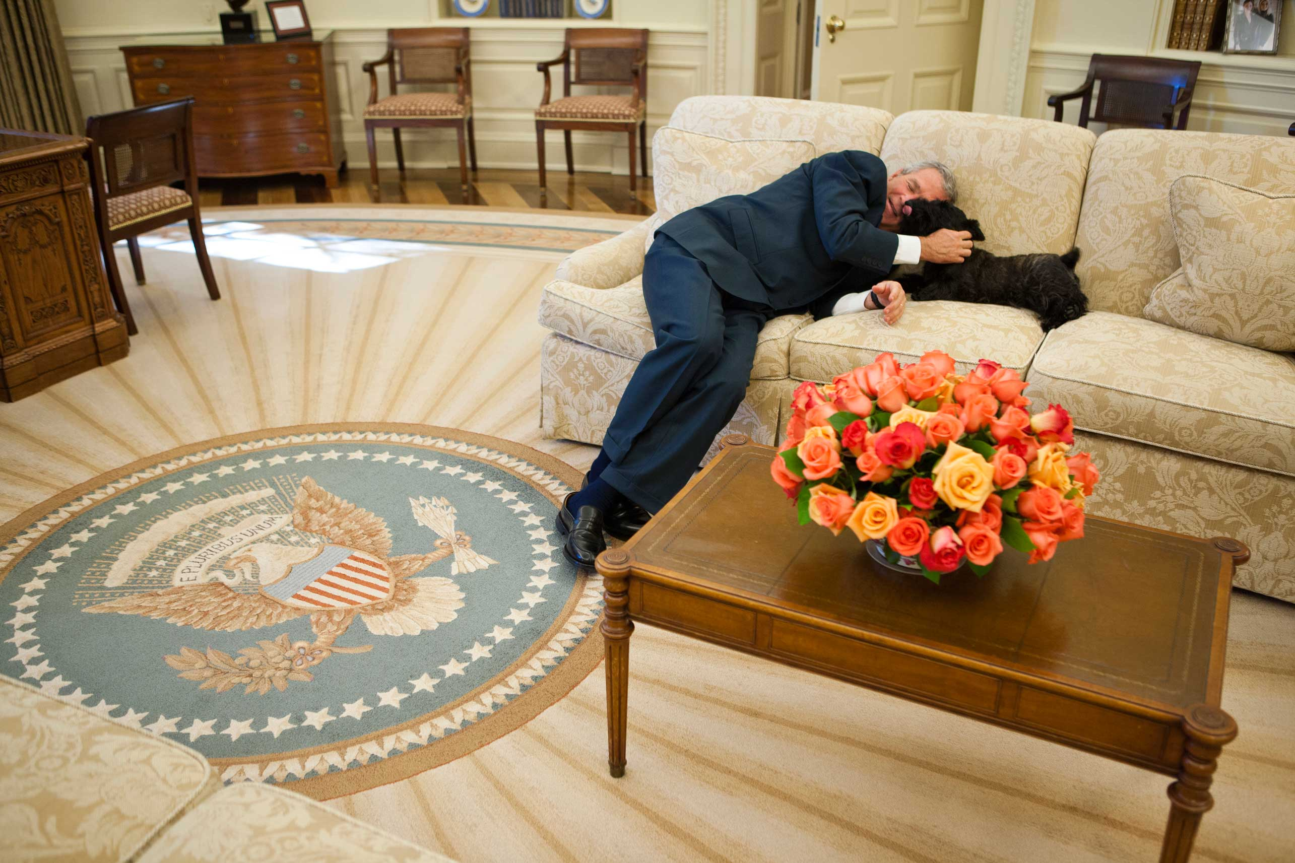 President George W. Bush is joined on the Oval Office couch by Miss Beazley between meetings at the White House on Oct. 20, 2006.