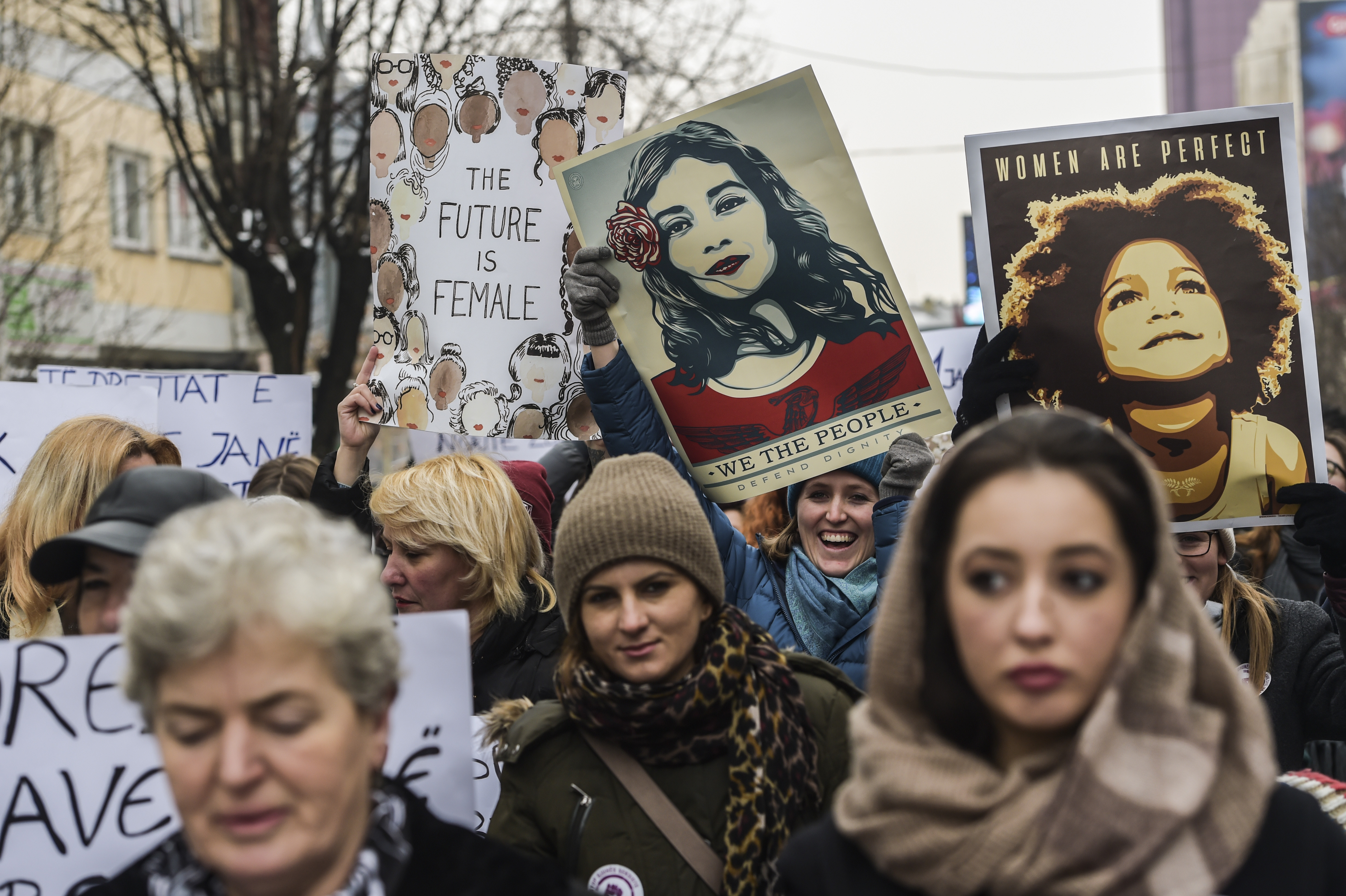 Women protest in solidarity with the march organized in Washington, on Jan. 21, 2017 in Pristina, Kosovo.