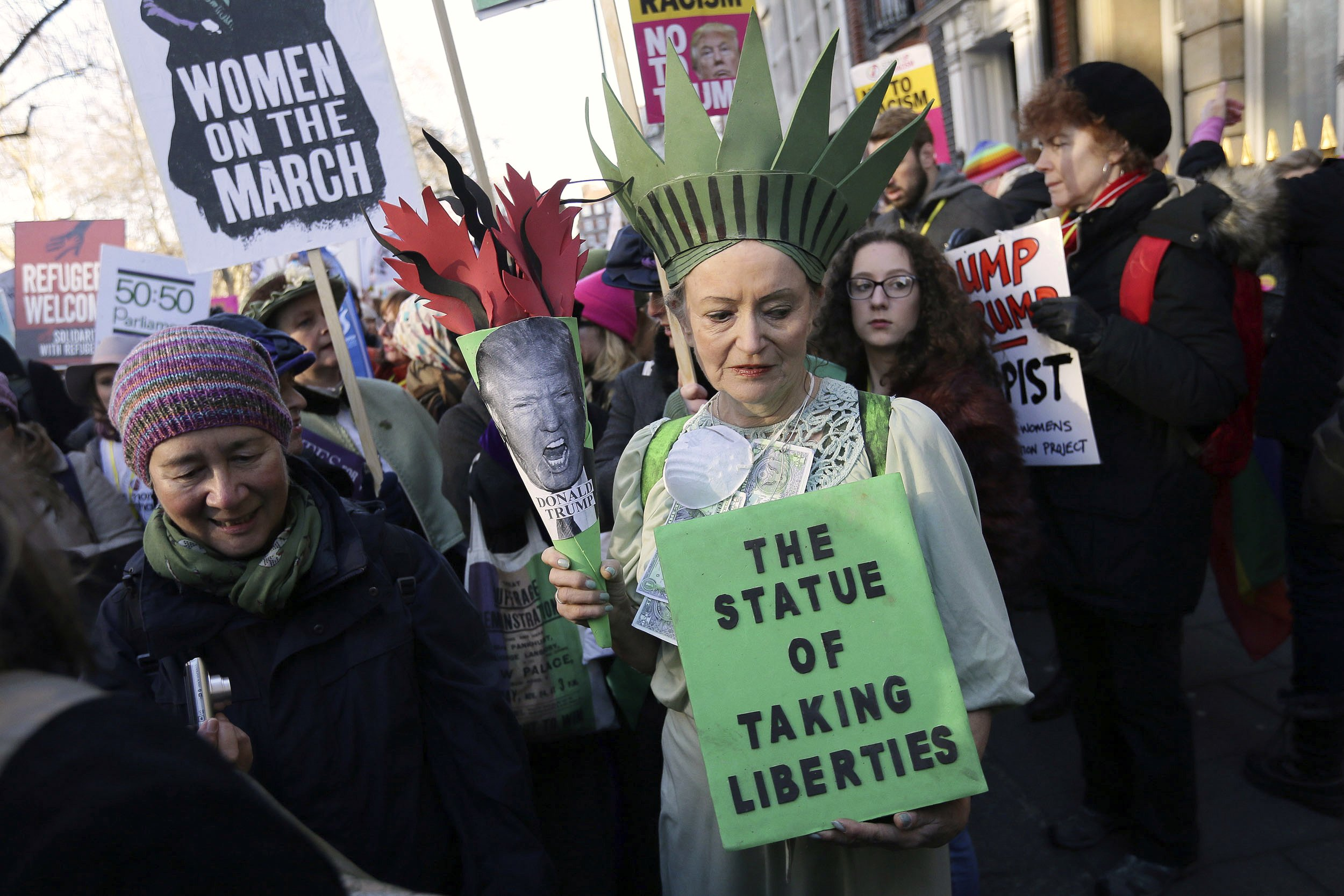 Demonstrators take part in the Women's March following the Inauguration of President Trump, in London, on Jan. 21, 2016.