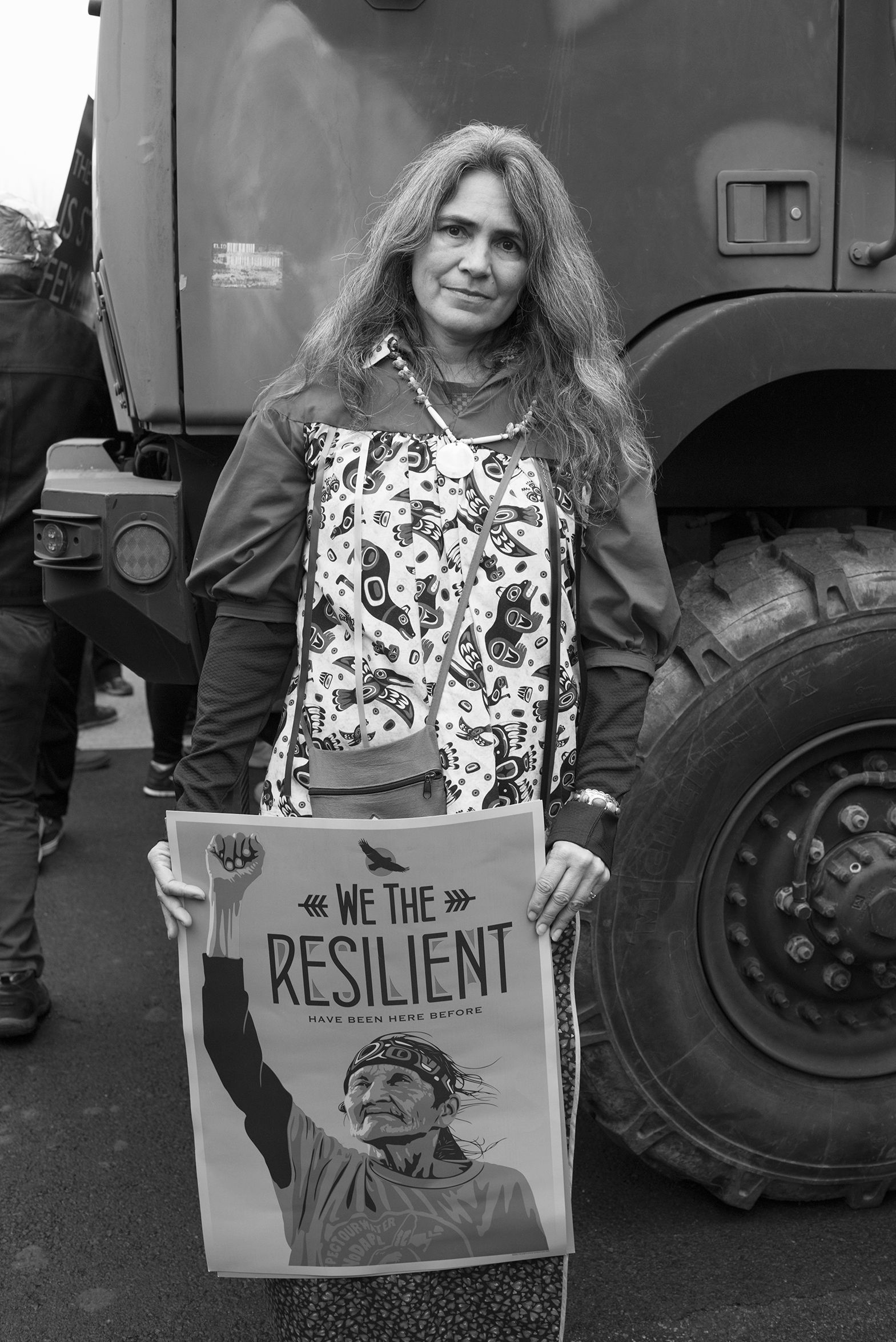 <b>Janice Posnikoff, Washington DC area</b>                                                                      I'm here representing the territory of my mother,  Lillian Posnikoff from Alert Bay Canada and her ancestors, the Kwakwa̱ka̱'wakw people. Can't you feel what we're getting out of this march?  It's unity, it's solidarity, it's everything that we all wanted. It's sending the clear message that absolutely, absolutely he's not the popular president and we're going to fight every inch of the way, every time it looks like corruption is happening or injustice is happening, and all of it.