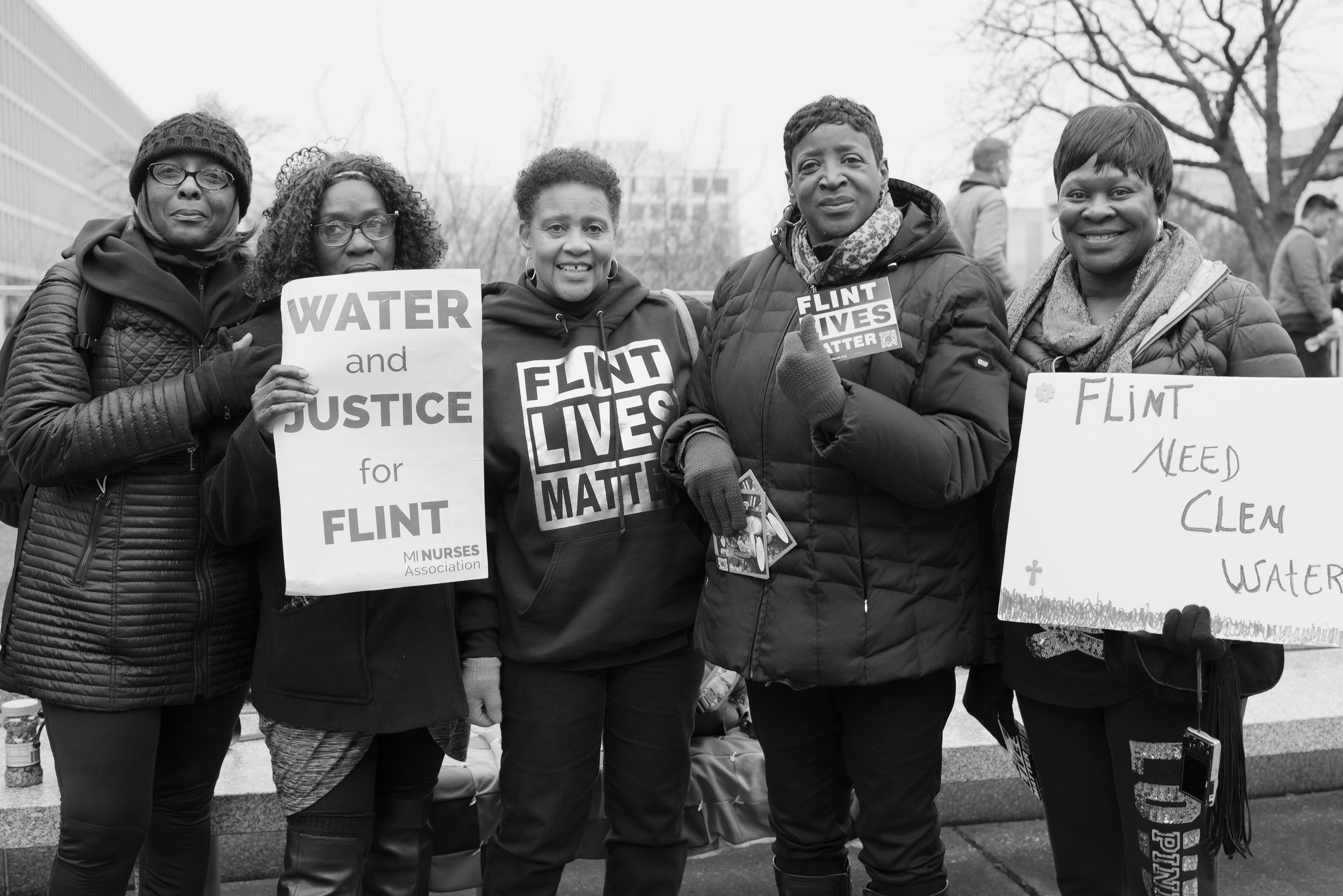 "These members of the Democracy Defense League came from Flint, Mich. to make sure  that city's water crisis isn't forgotten.   ""We are women and we're standing up for our rights to clean water,"" says Carrie Younger-Nelson (third from the left)."