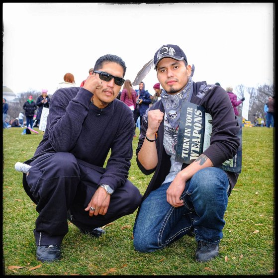 "Madmax, right, 22 from New York City, with Chaske, 29, from Minneapolis. Both came to Washington to shed light on the situation in Standing Rock: ""People like me are being arrested and charged for felonies that we don't deserve. I was charged for two felonies, reckless endangerment and criminal mischief,"" Madmax told me. Chaske added: ""I came to support 'Sioux Z Dezbah' [a water protector who was injured in one eye] and all that she is doing to highlight our plight. I am here to support the women and to watch their backs."""
