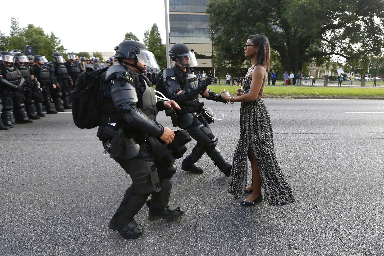 Lone activist Ieshia Evans stands her ground while offering her hands for arrest as she is charged by riot police during a protest against police brutality outside the Baton Rouge Police Department in Louisiana, USA, on July 9, 2016.