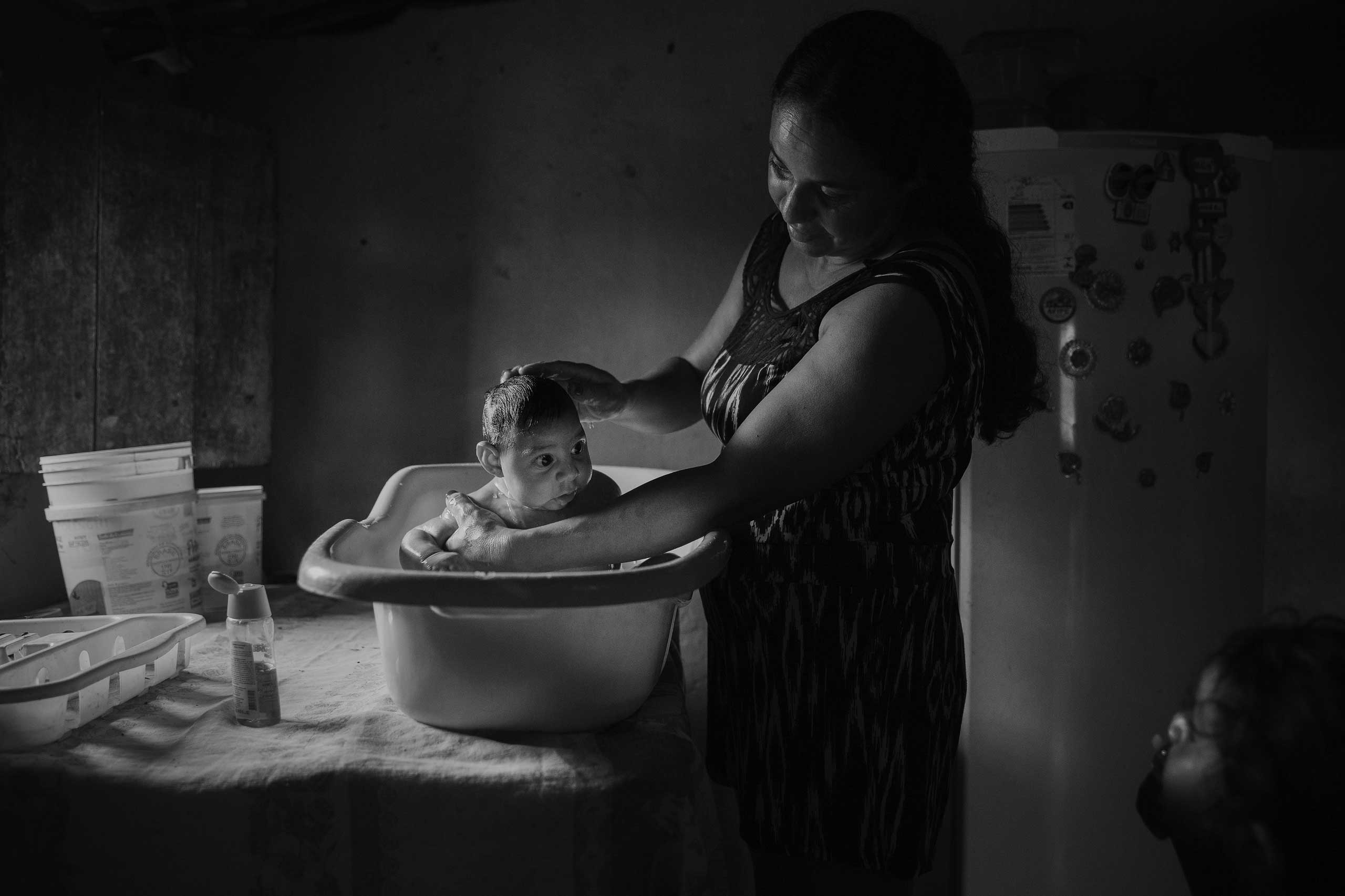 Adriana Cordeiro Soares, 30, bathes her son João Miguel, 3 months old, who was born with microcephaly caused by the Zika virus, in her house in the rural area of São Vicente do Seridó.