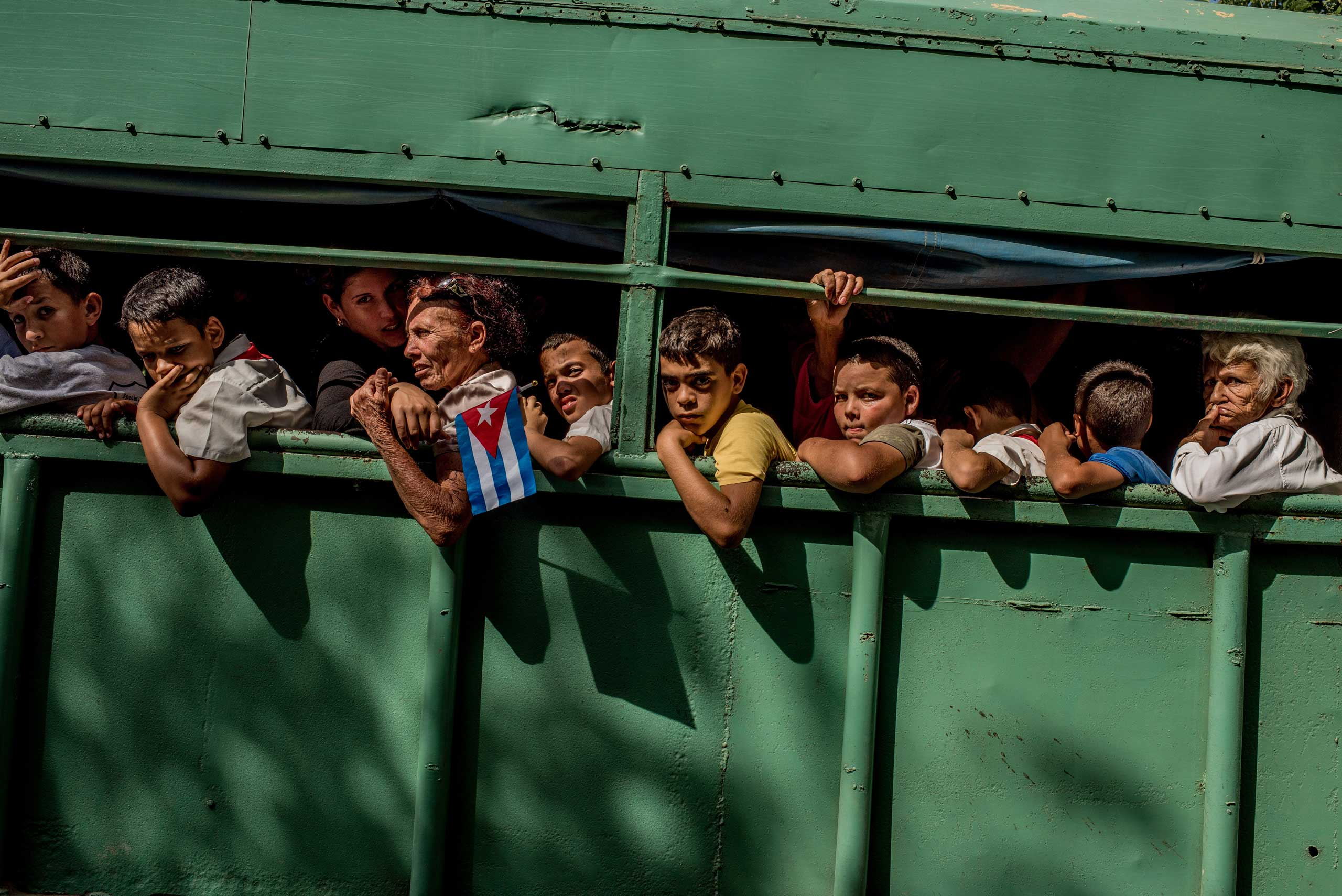 Trucks carried students home after the carriage carrying Fidel's ashes passed in Las Tunas Province, Cuba on Dec. 2, 2016.