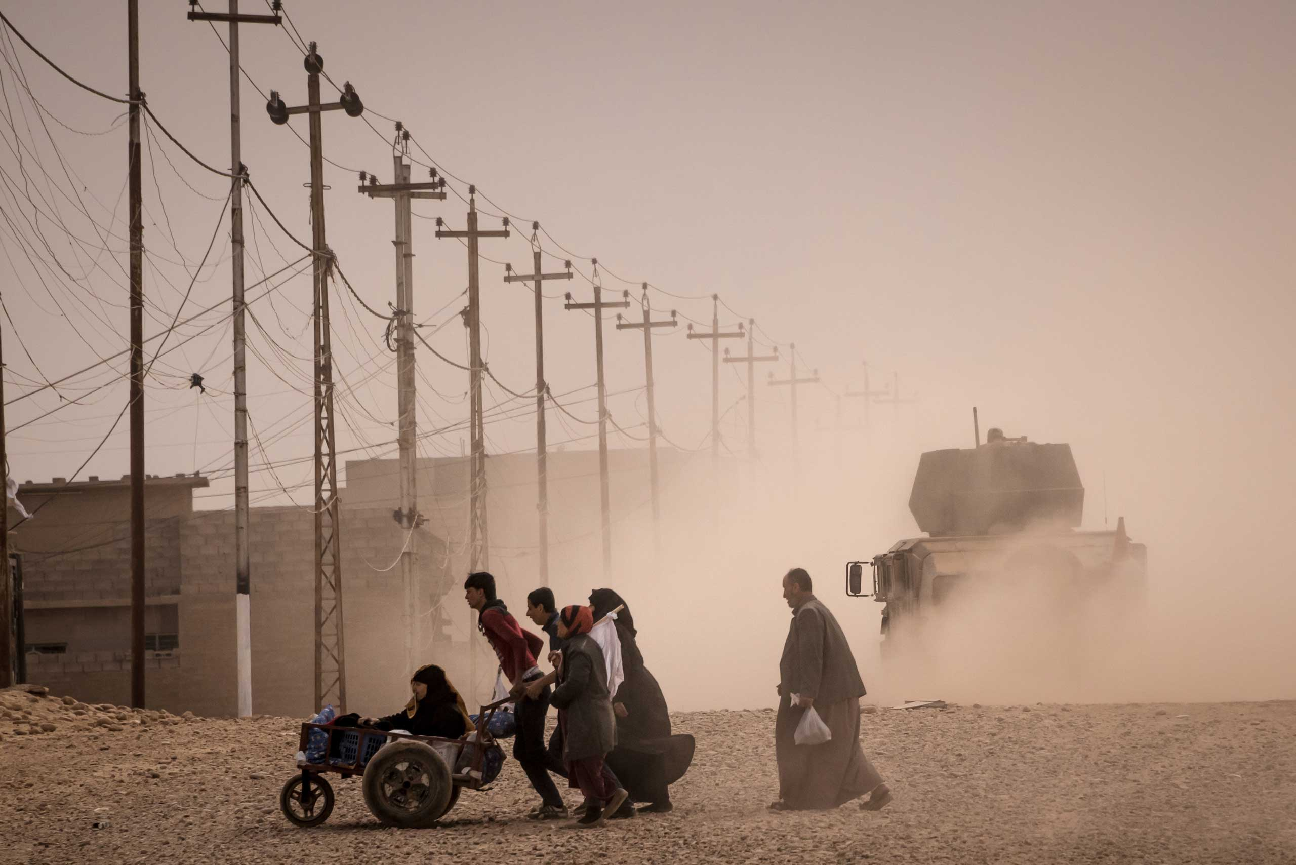 Residents of Mosul flee the city amid fighting between Iraqi forces and the Islamic State in Mosul, Iraq on Nov. 16, 2016.