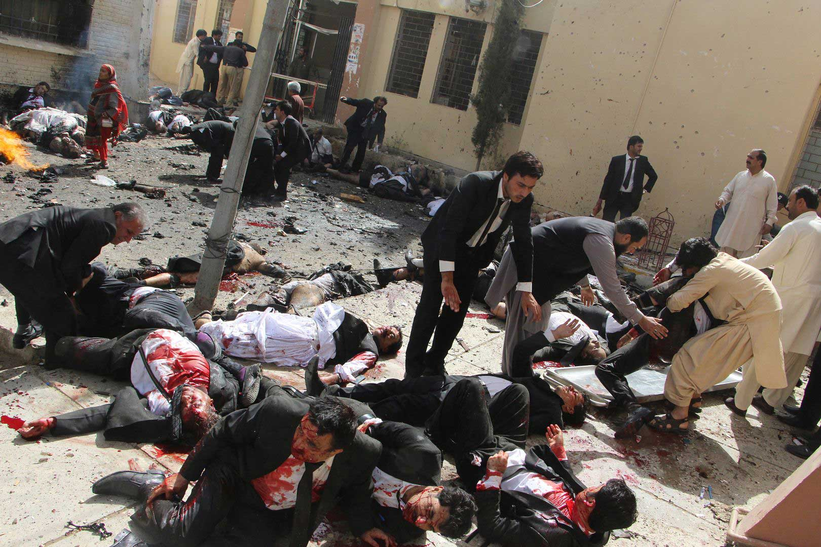 Lawyers help their injured colleagues after a bomb explosion in Quetta, Pakistan, on Aug. 8, 2016. Seventy people were killed when a bomb exploded outside a civil hospital where a crowd of lawyers and journalists had gathered to mourn Bilal Anwar Kasi, a senior lawyer who had been assassinated hours earlier.