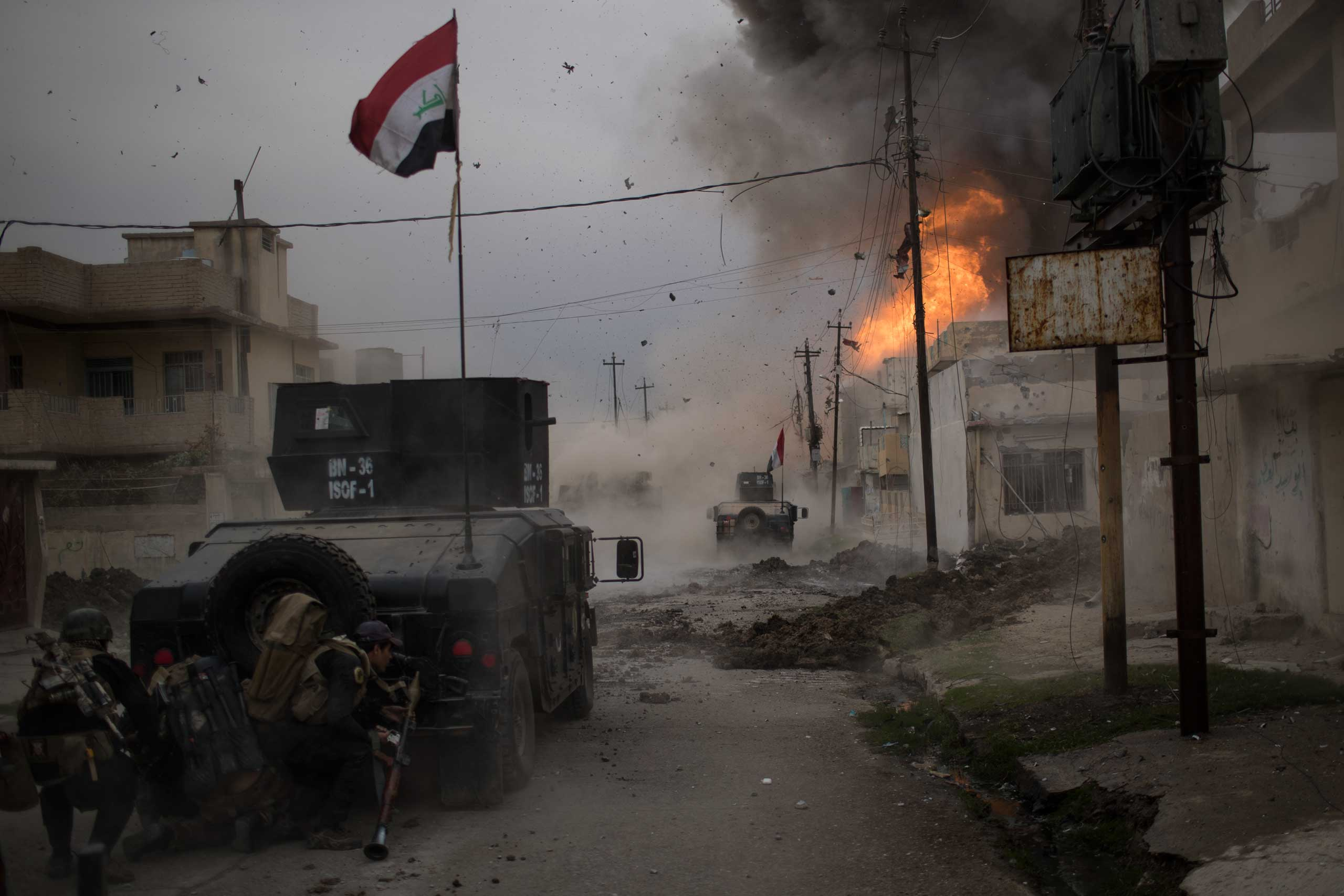 A car bomb explodes next to Iraqi special forces armored vehicles as they advance towards Islamic State-held territory in Mosul, Iraq, on Nov. 16, 2016.