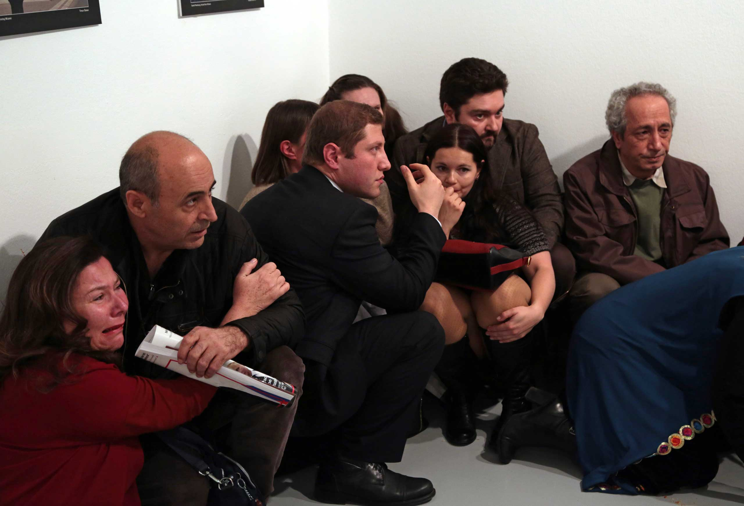 Gallery goers cower after Mevlüt Mert Altıntaş shot Andrey Karlov, the Russian ambassador to Turkey, at an art gallery in Ankara, Turkey.