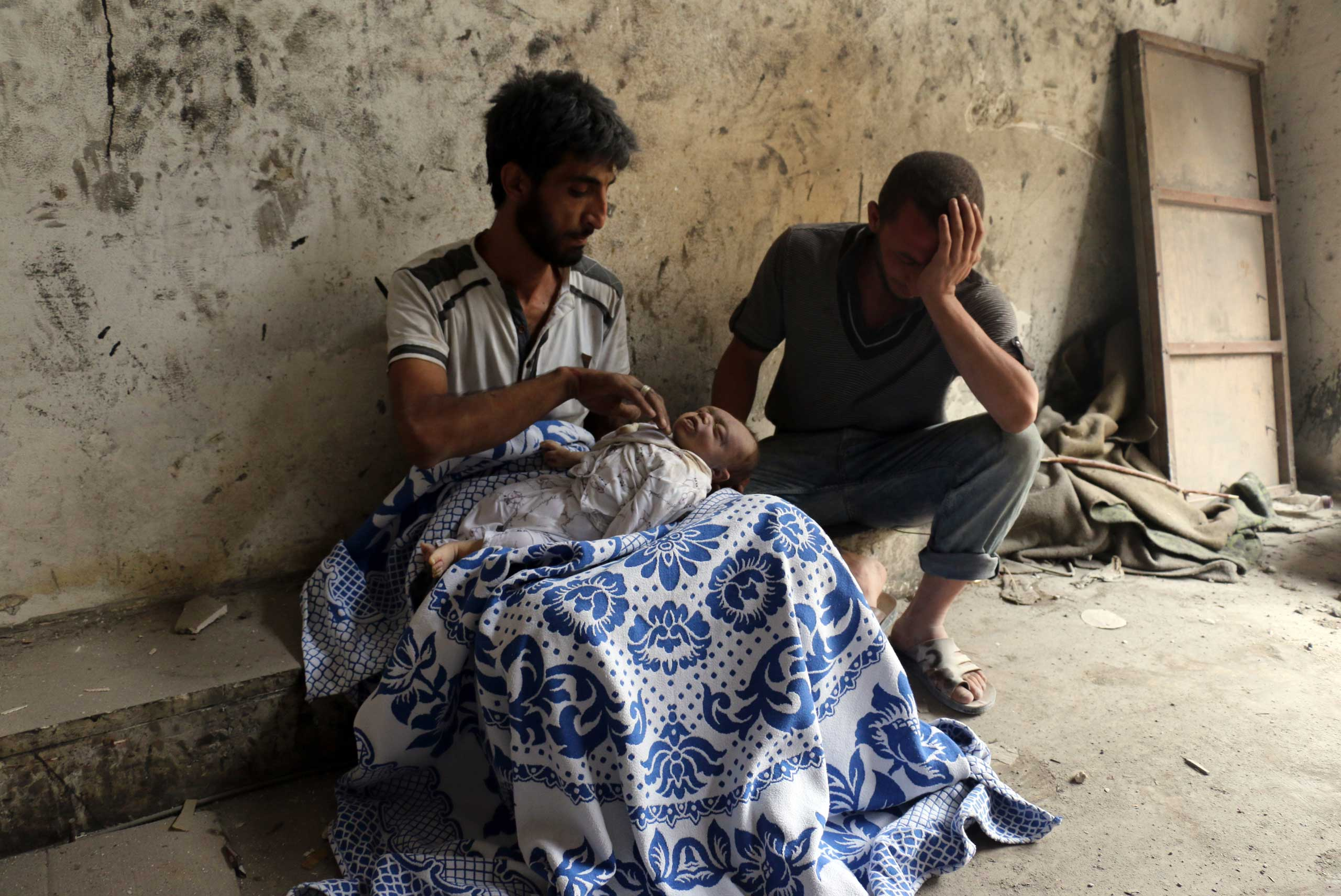 EDITORS NOTE: Graphic content / Syrians mourn over the body of baby following bombardment on the al-Marja neighbourhood of the northern Syrian city of Aleppo on Sept. 23, 2016.
