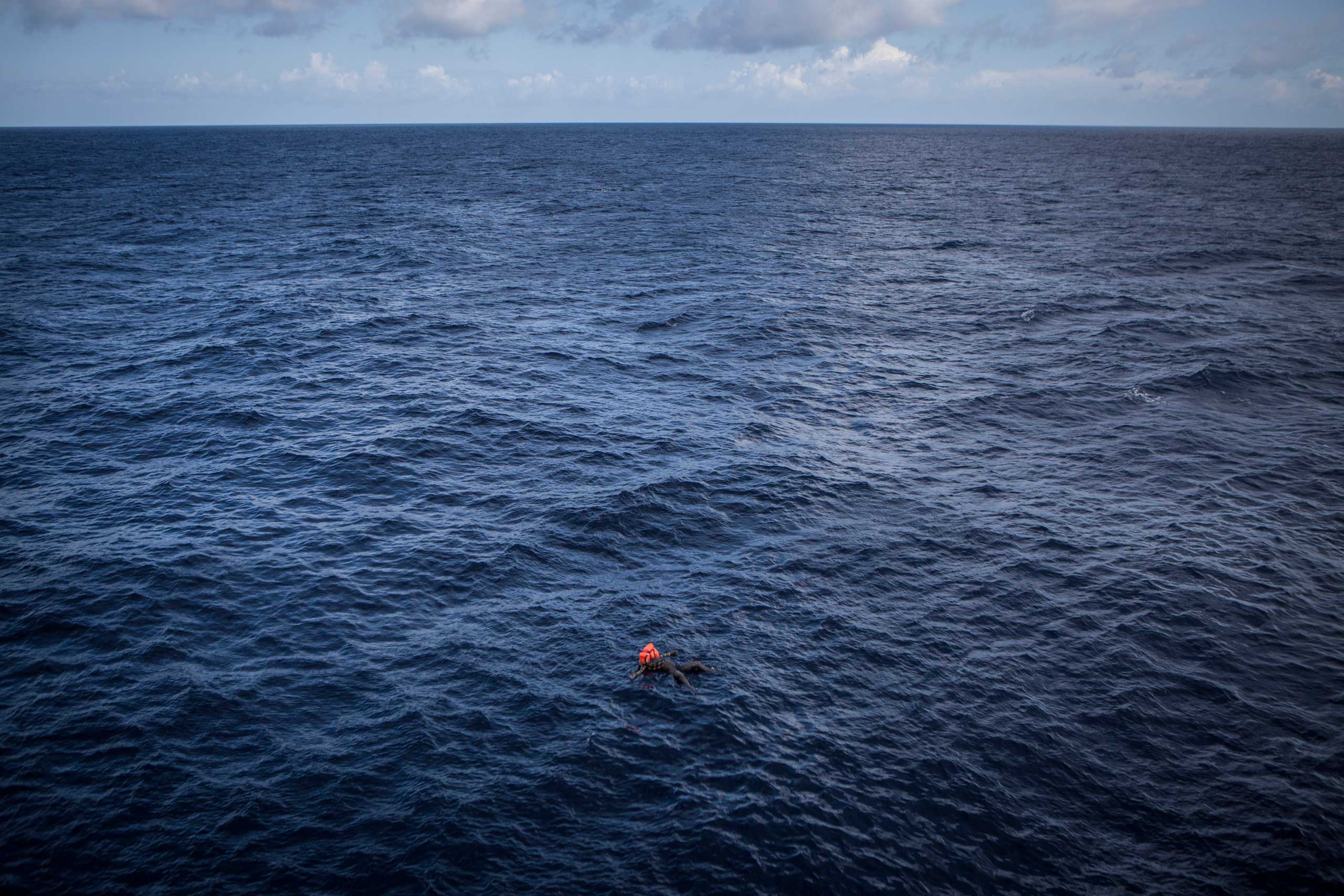The body of a migrant found floating at sea. Red Cross medical staff onboard the Responder estimated he had been at sea for at least four days.
