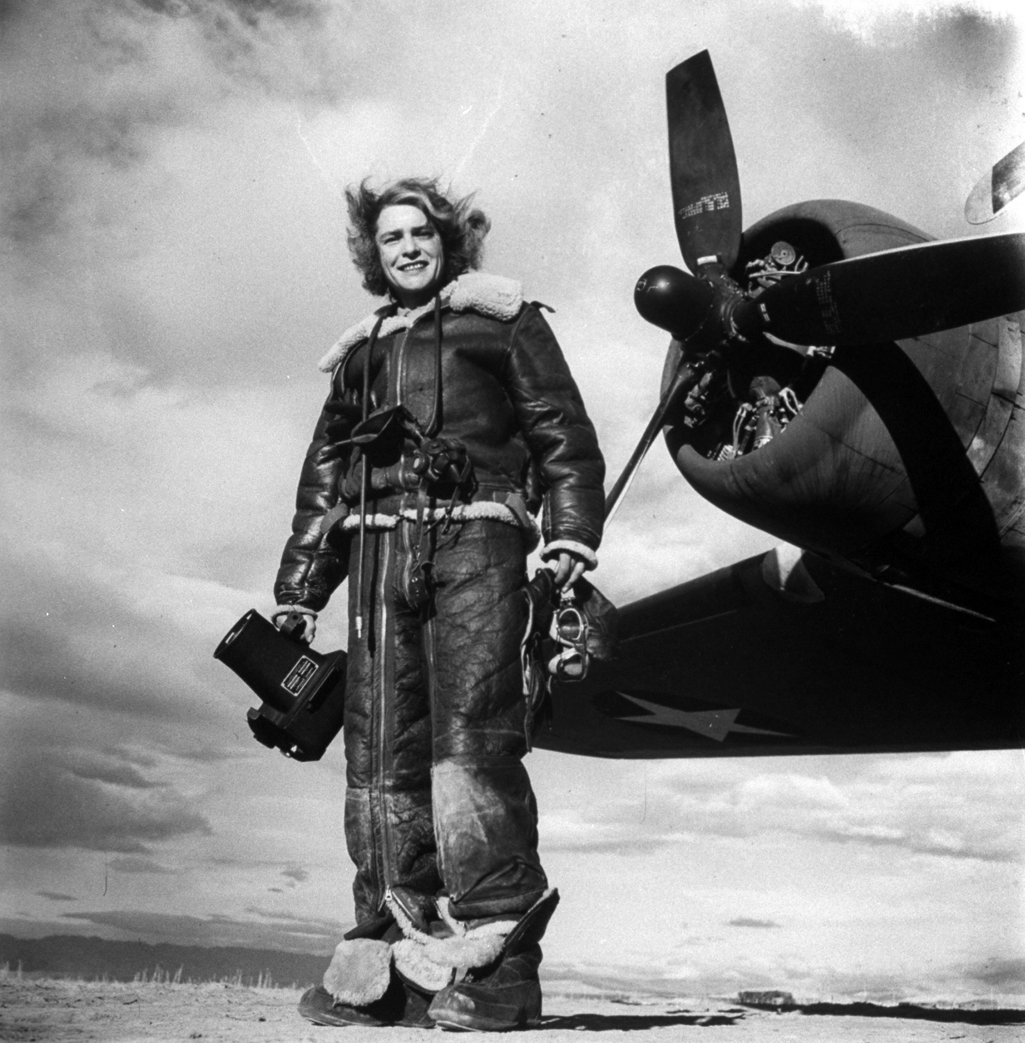 <b>Caption from LIFE.</b> Miss Bourke-White in regalia of air photographer.