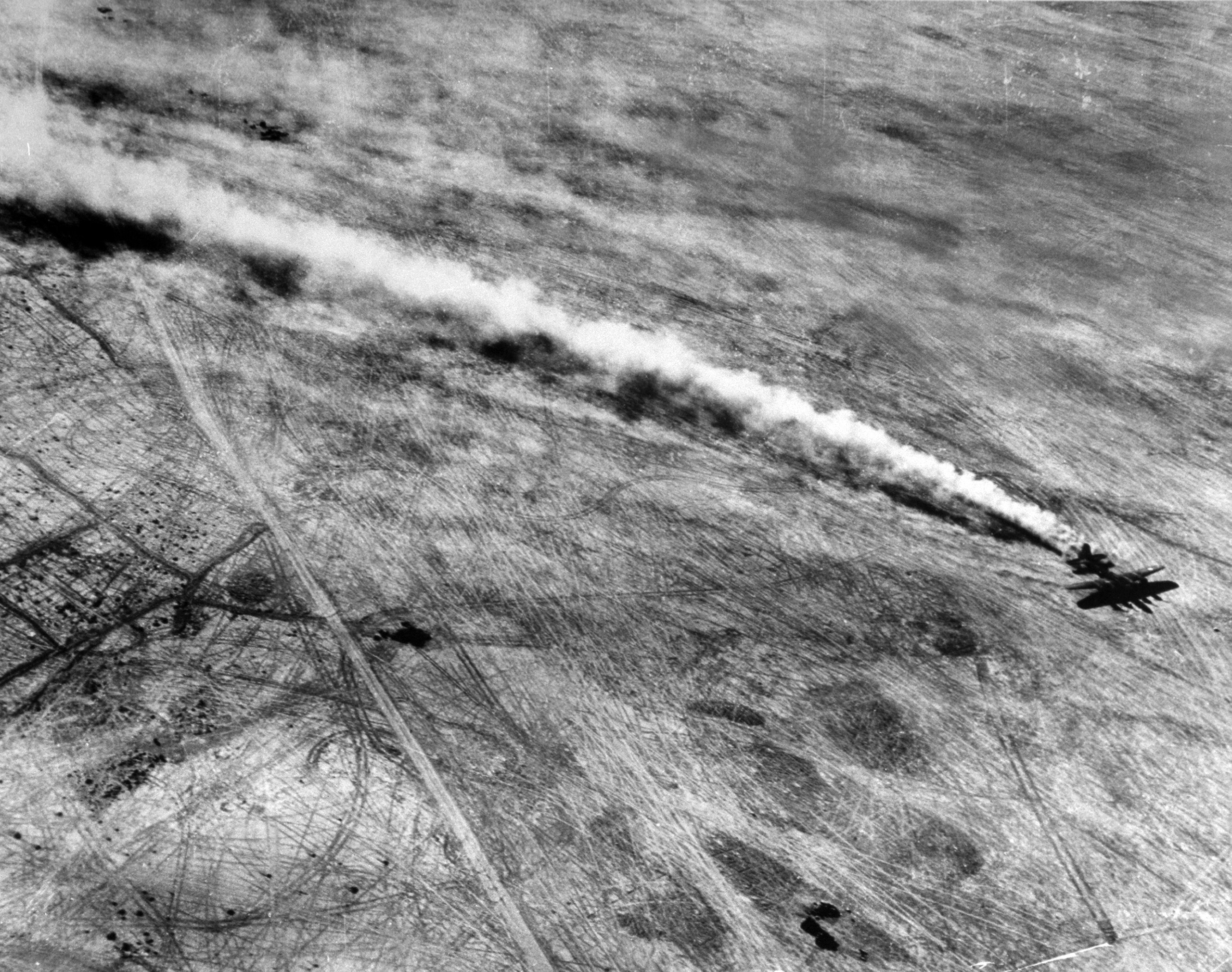 <b>Caption from LIFE.</b> The take-off is at 8:55 am. One by one Fortresses roar down the field, climb into the clear African sky, compose their elements and squadrons and head for Tunis. Noe sand streaming in wake of plane. In this desert post, sand is the insidious Axis agent that sabotages motors and spoils food. Few weeks ago, in fields nearer the coast, mud was the fliers' No. 1 gripe.
