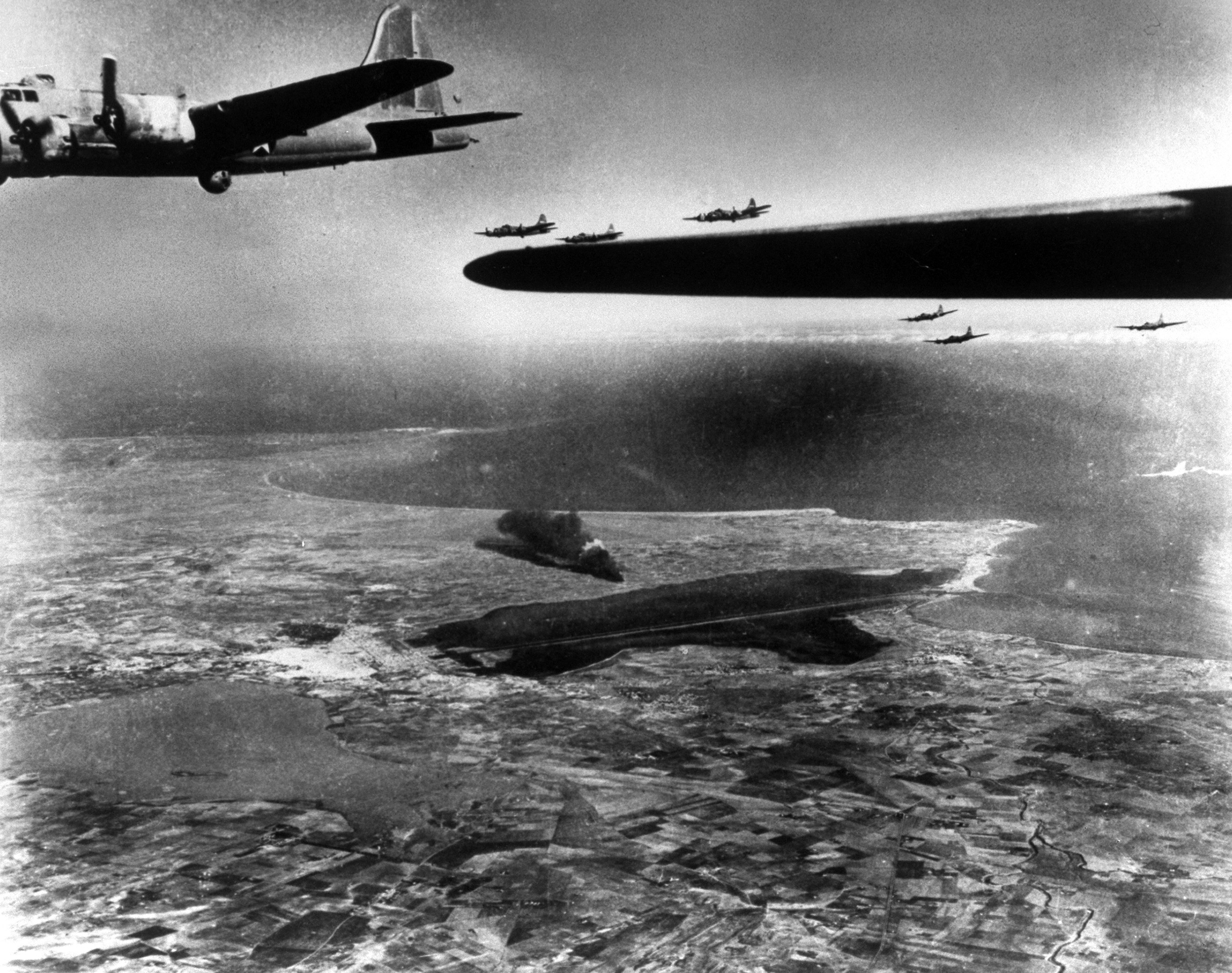 <b>Caption from LIFE.</b> Fortresses head for home leaving great smoke columns rising from bombed planes and fuel dumps on Tunis airport. In this picture you are looking Northeast across Tunisian coastal plain to Mediterranean. In upper left corner lies Bizerte.