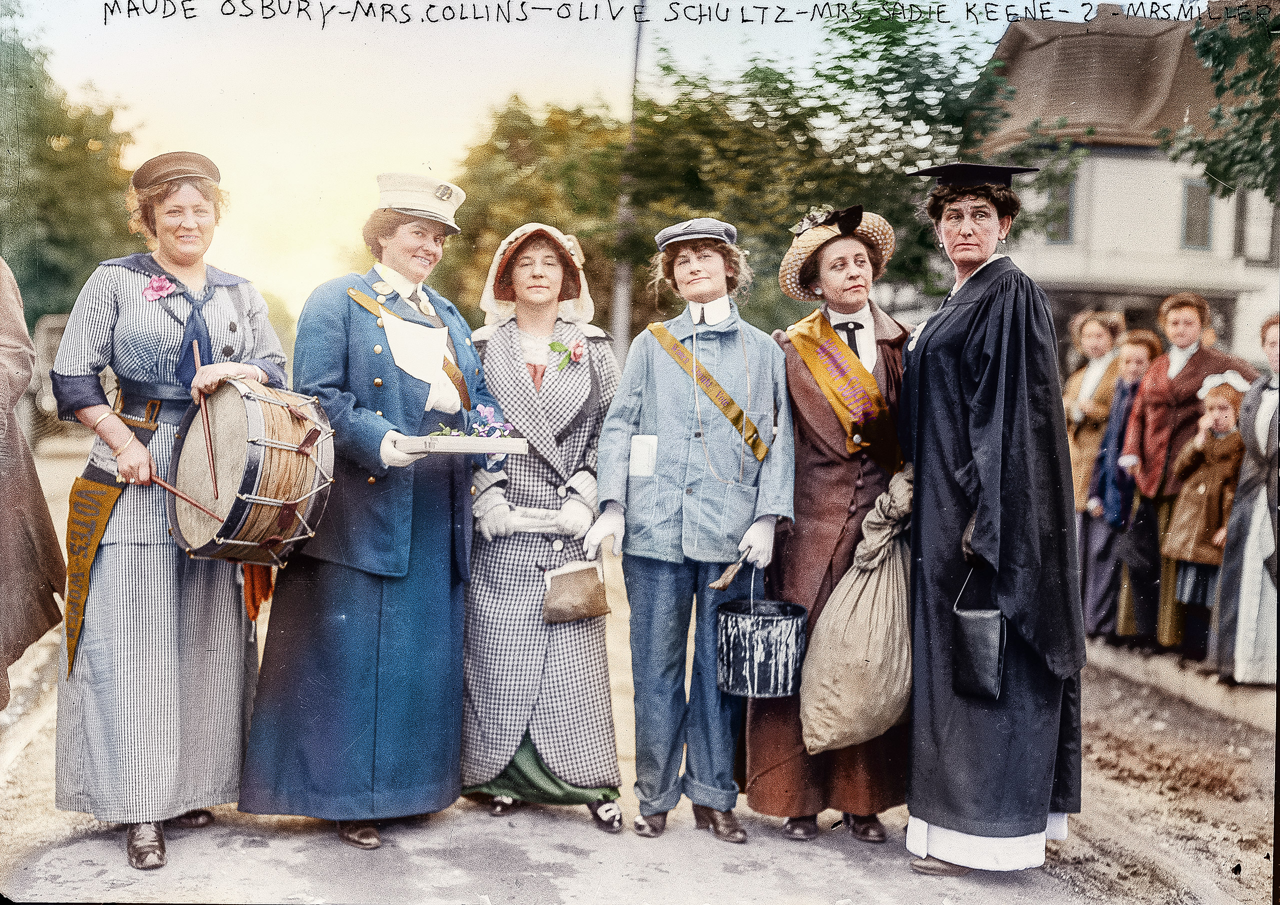 A Women's Suffrage Parade in Long Island, 1913. Mrs. John Ocksbury marching as a drummer and Miss Grace Collins marching as a fire department captain.
