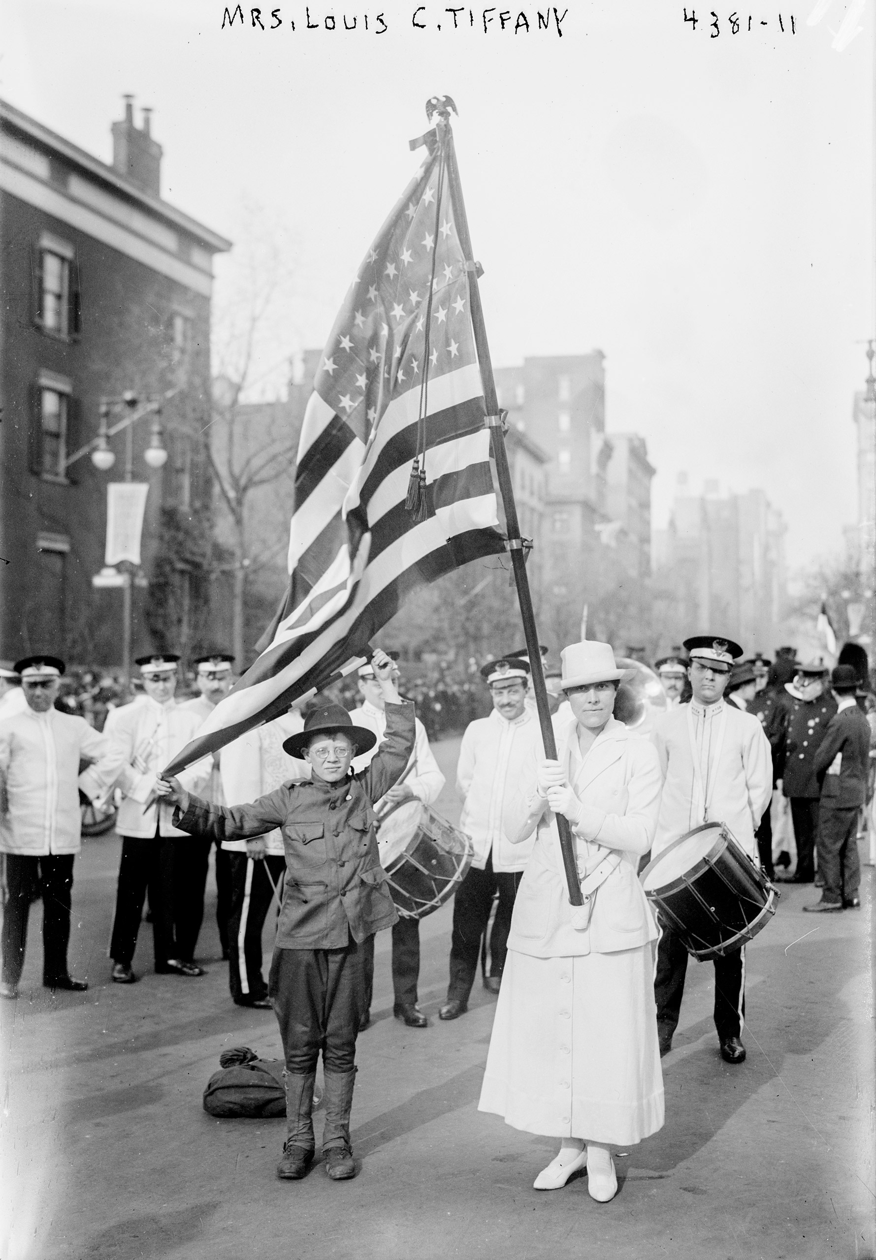 Mrs. Charles Lewis Tiffany, née Katrina Brandes Ely, carrying a flag in suffrage parade, New York City, Oct. 27, 1917.