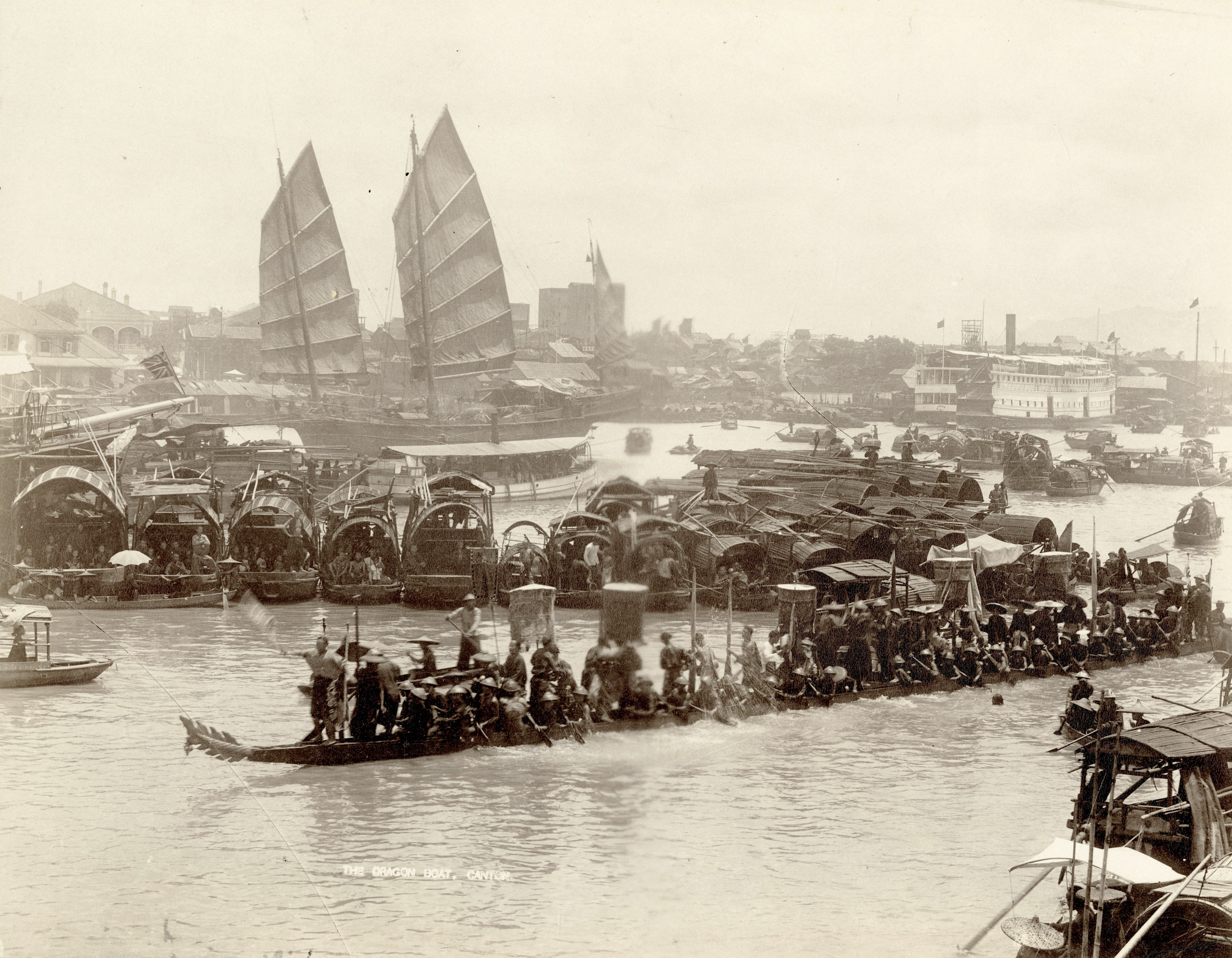 Caption from Stephan Lowentheil Collection. The Dragon Boat race, seen here on a crowded Guangzhou waterway, was held during the Duanwu (Dragon Boat) Festival. The annual event, held on the fifth day of the fifth month of the traditional Chinese calendar, commemorates the life and death of the Chinese scholar Qu Yuan. The race is accompanied by beating drums. It is traditionally believed that the winners will have a year of luck.