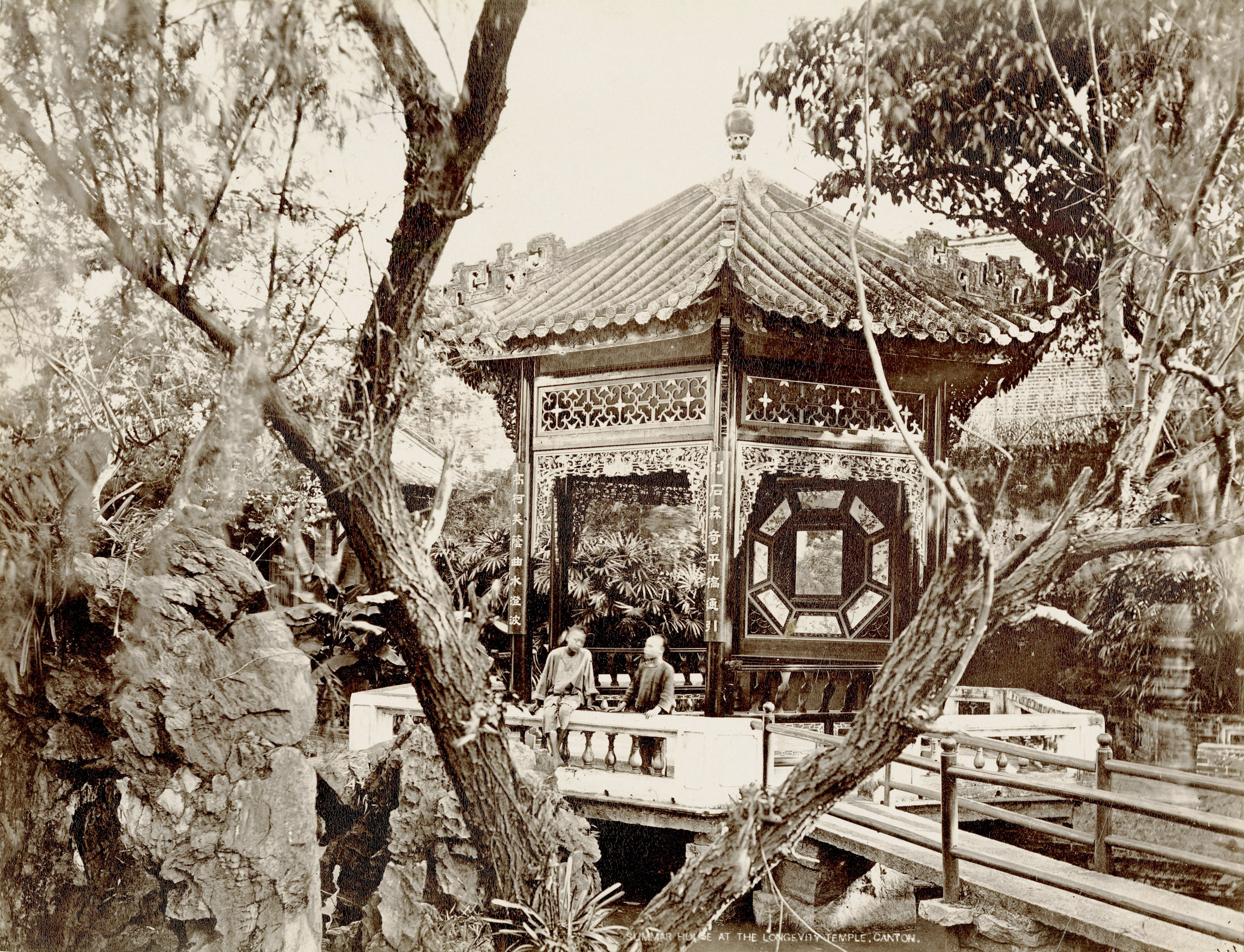 Caption from Stephan Lowentheil Collection. This photograph shows a wealthy merchant's garden and pavilion in Guangzhou. Most Chinese gardens reflect a desire to establish harmony between natural elements and man-made structures. Such gardens often offer space for solitude and contemplation while also serving as the settings for banquets and celebrations.